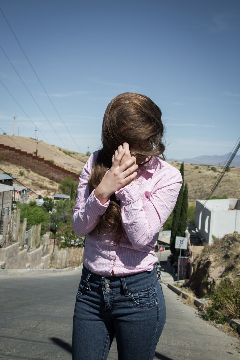 Johanna, who lives in Nogales, near the fence which divides the town between Arizona, US and Sonora, Mexico. Arizona Blue Border Border Town Day Girl Lifestyles Long Hair Nogales Outdoors Sonora Trapped Us Mexico Border Young