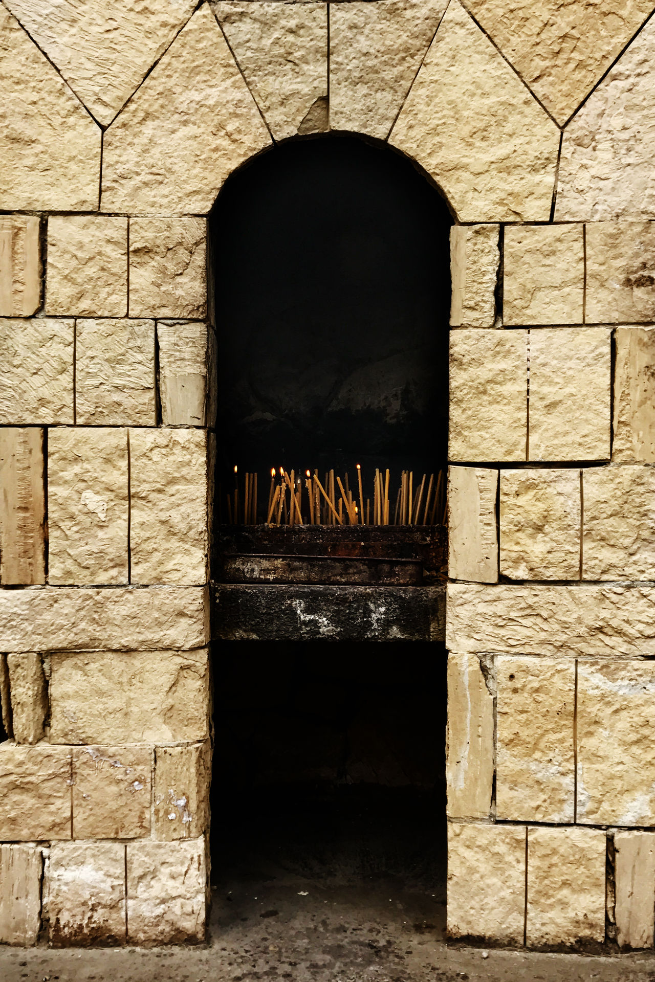 Arch Architecture Brick Wall Building Exterior Built Structure Candle Candle Flame Candlelight Day No People Outdoors Pilgrimage Pilgrimage Church Spirituality