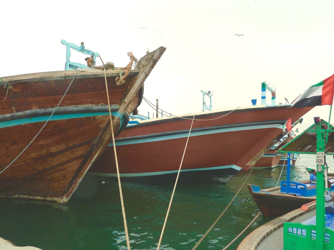 nautical vessel, transportation, mode of transport, moored, boat, sea, longtail boat, water, outdoors, wood - material, no people, day, beach, nature, sky