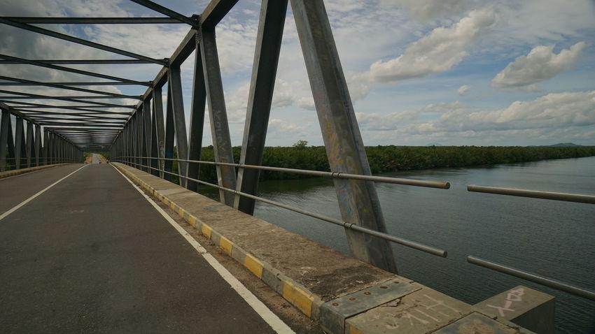 the bridge in Pangkalpinang , Bangka. Bridge Over Water Bridge Photography Bridge Over The River Photography By @jgawibowo Arif Wibowo Photoworks Shot By @jgawibowo Shot By Arif Wibowo Property Of Arif Wibowo Like Likeforfollow Cloud - Sky Sky Road Steel Outdoors