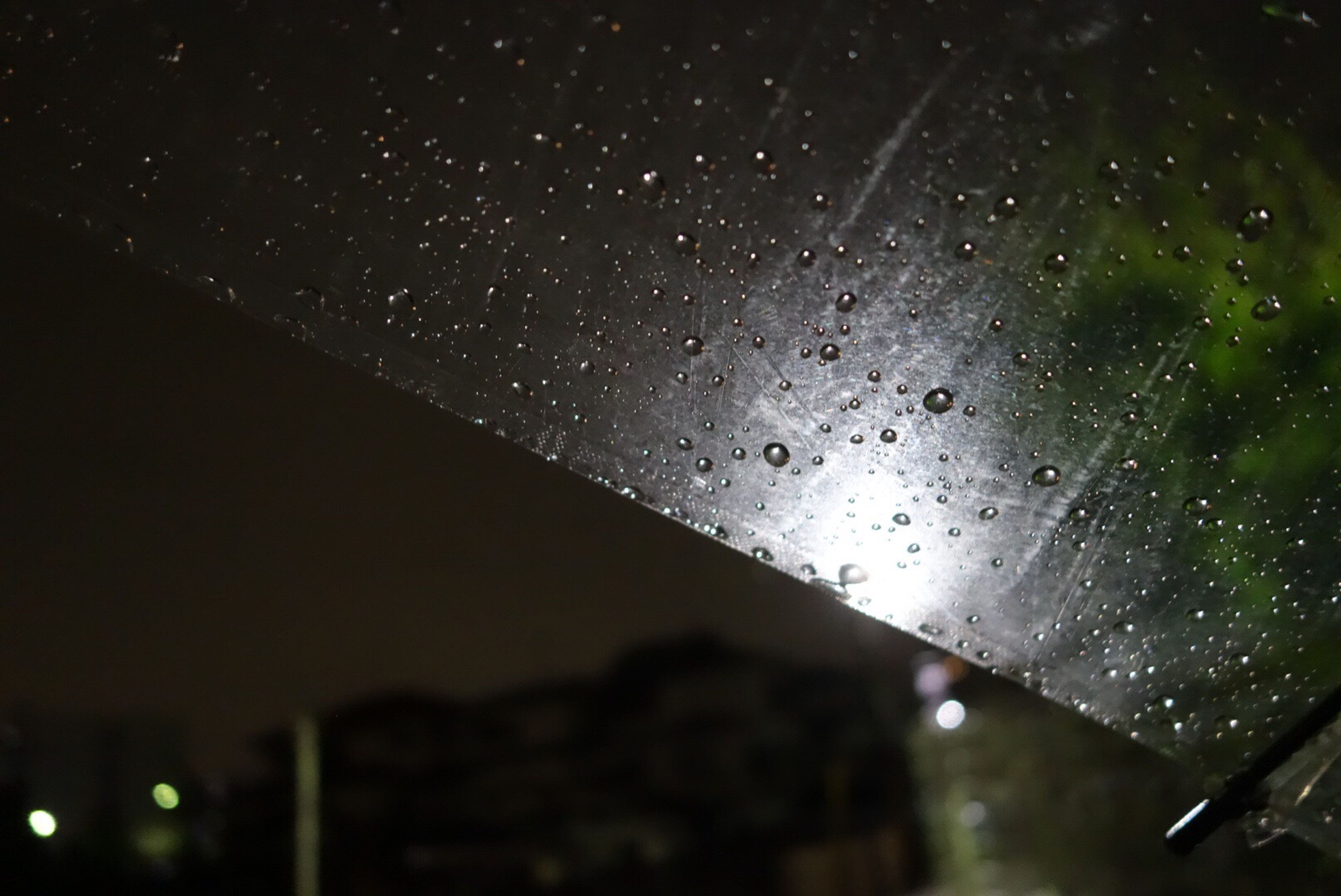 drop, glass - material, water, wet, window, rain, focus on foreground, rainy season, close-up, sky, raindrop, nature, no people, beauty in nature, outdoors, night