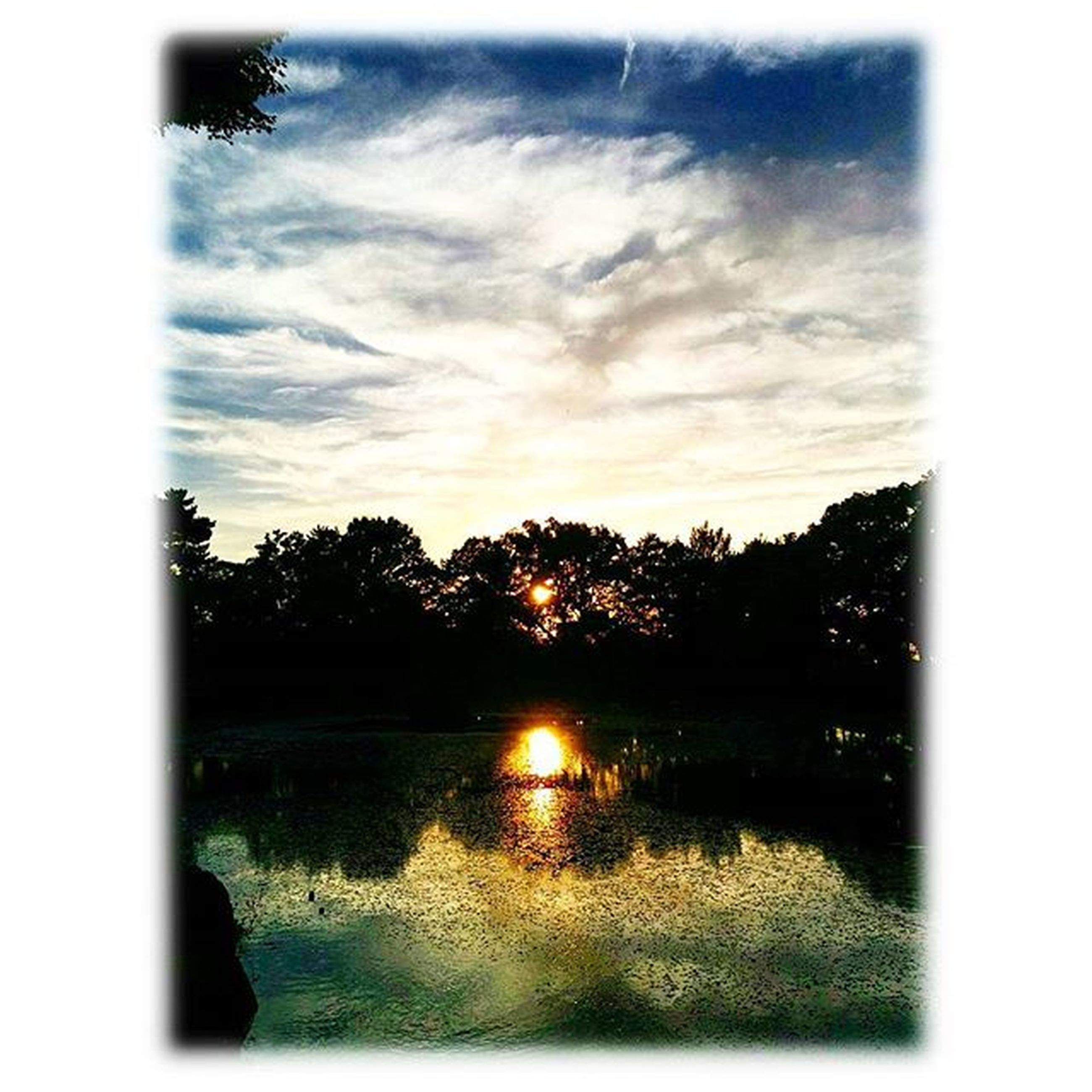 transfer print, water, sunset, sky, auto post production filter, tree, reflection, tranquil scene, silhouette, lake, tranquility, scenics, beauty in nature, cloud - sky, sun, nature, river, idyllic, cloud, waterfront