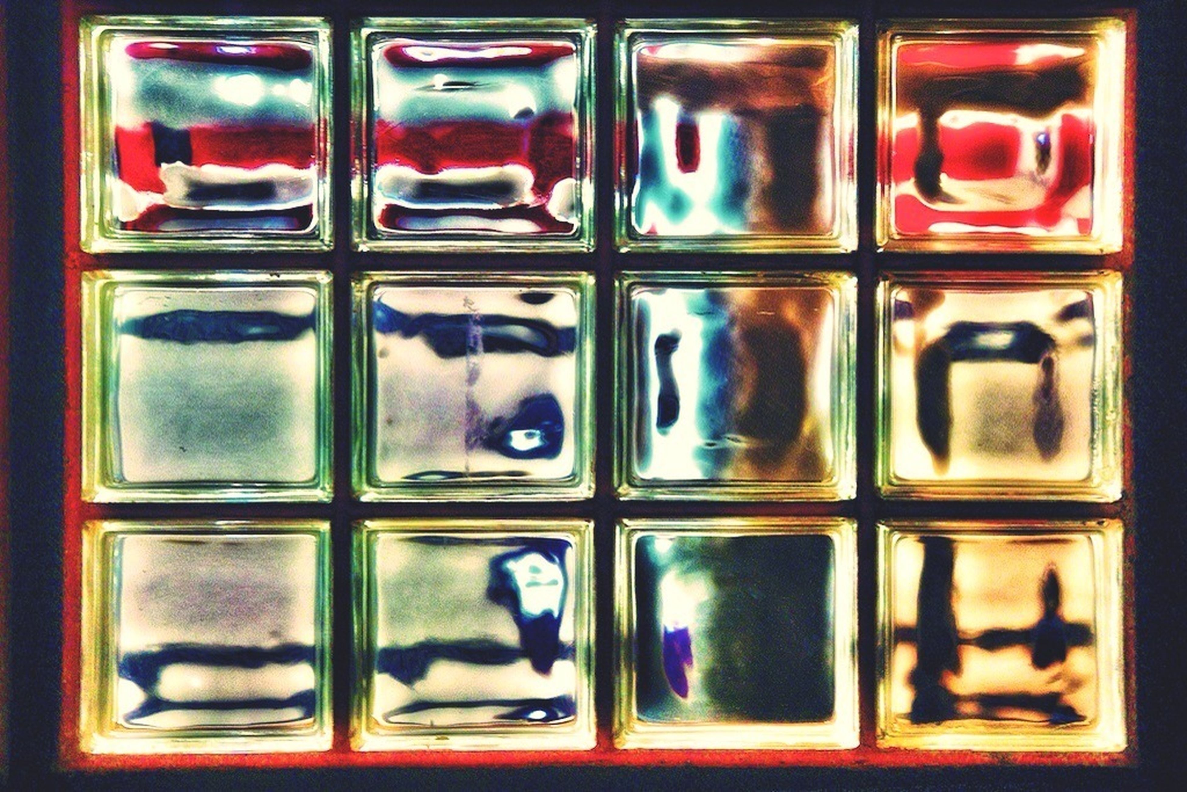 full frame, indoors, backgrounds, close-up, red, glass - material, in a row, no people, repetition, side by side, pattern, door, still life, closed, security, metal, transparent, window, protection, safety