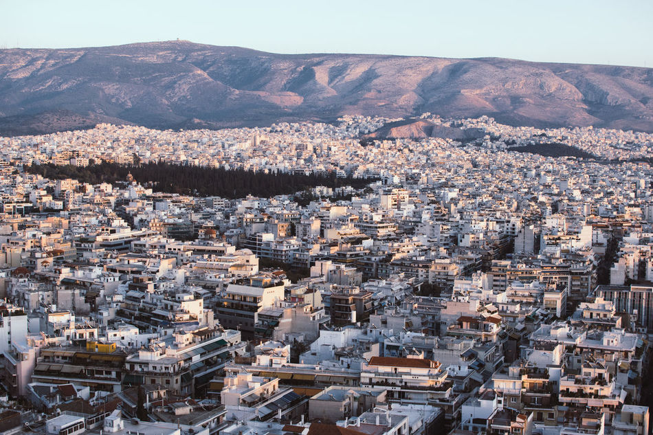From one hill to another in Athens Aerial View Architecture Building Exterior Built Structure City Cityscape Mountain No People Outdoors Roof Sunset Travel Destinations Urban Skyline