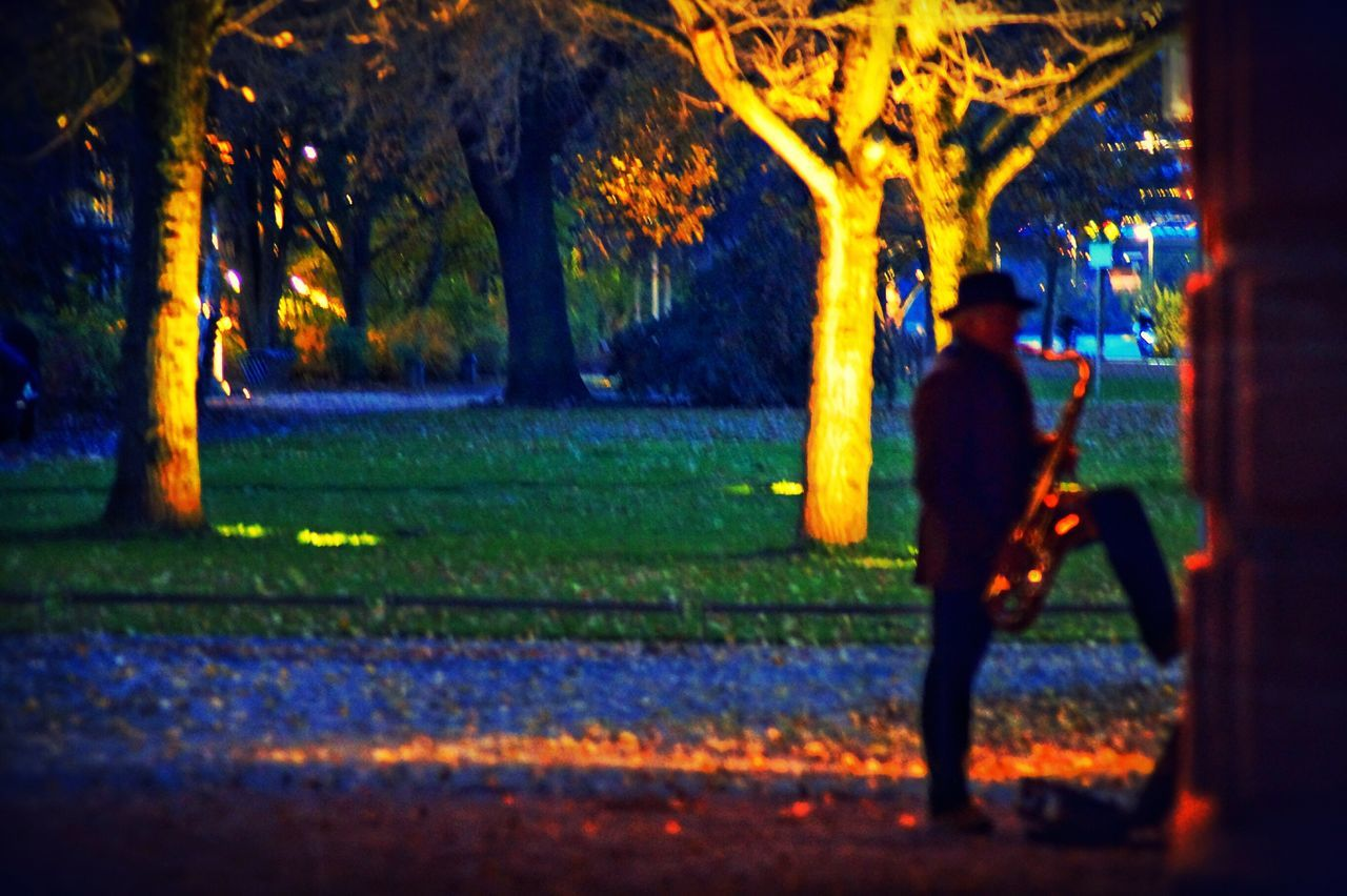 The Blue Hour Magical Moments Lonely MusicianPlaying Saxophone Early Evening Blur Blurred Visions Under The Bridge On The River Bank  Main River Bank Tranquil Scene Illuminated Urban Exploration Real People Lifestyles City Life Cityscapes Trees And Bushes Silhouettes Frankfurt Am Main Germany🇩🇪 Chance Encounters