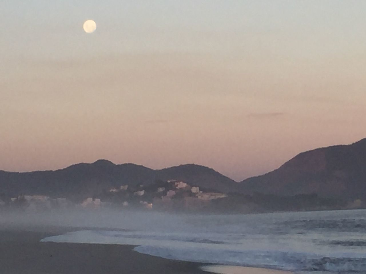 beauty in nature, nature, scenics, sunset, tranquility, sea, mountain, tranquil scene, moon, water, no people, outdoors, sky, mountain range, clear sky, beach, wave, day