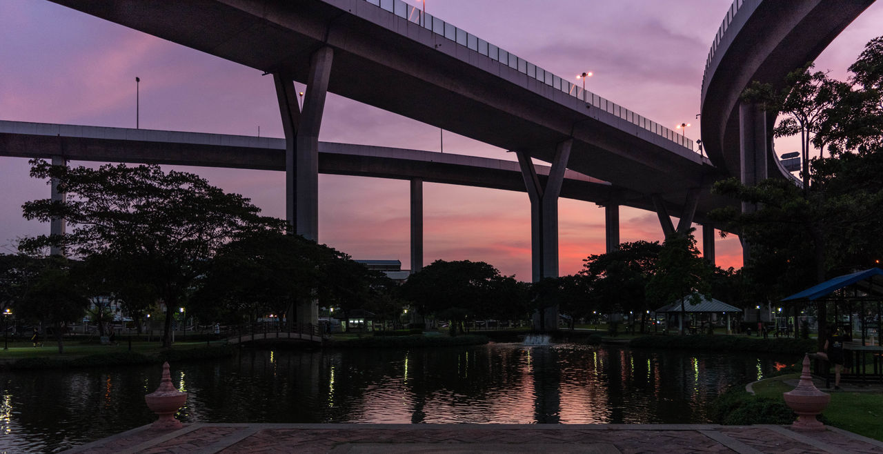 Architecture Bridge - Man Made Structure Building Exterior Built Structure City Day Dusk Illuminated No People Outdoors Reflection Sky Sunset Transportation Tree Water