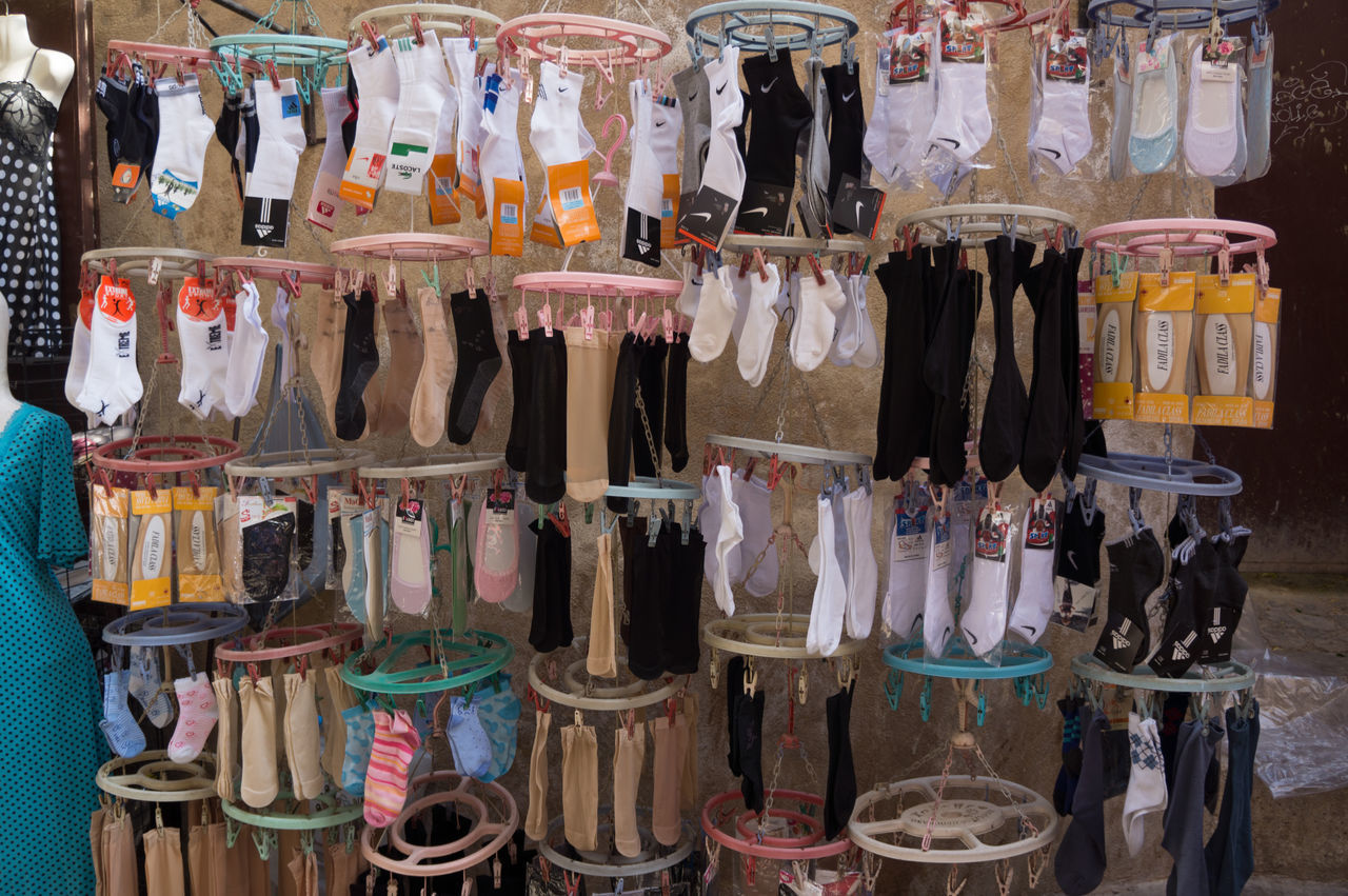 Arrangement Choice Collection Display For Sale Group Of Objects In A Row Large Group Of Objects Market Medina Moroccan Stall Market Moroccan Style Multi Colored No People Retail  Retail Display Side By Side Socks Stall Variation