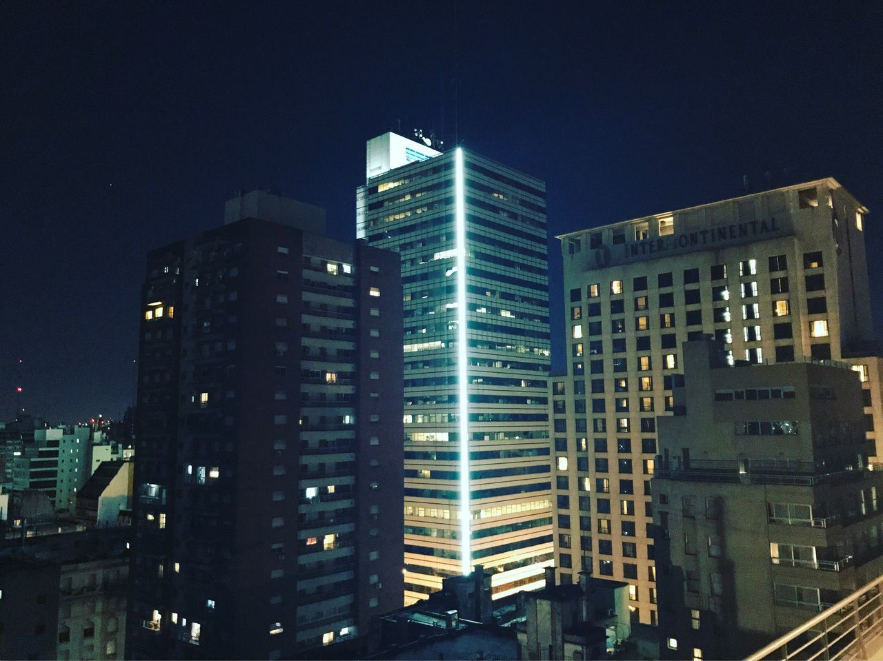 architecture, night, building exterior, illuminated, modern, city, skyscraper, built structure, no people, cityscape, outdoors