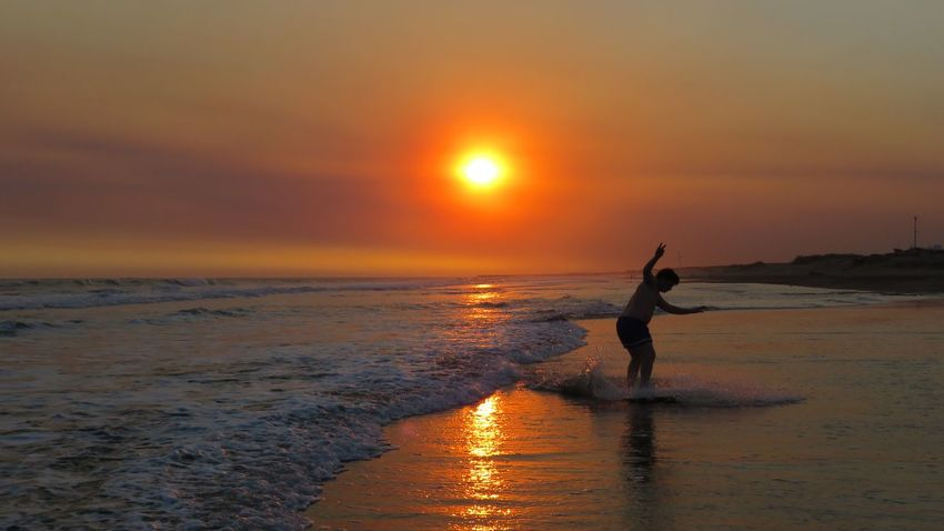 Beach Beauty In Nature Buenos Aires, Argentina  Day Full Length Horizon Over Water Human Body Part Nature Necochea. Argentina One Person Outdoors People Sea Silhouette Sky South America Sport Sun Sunset Vacations Water