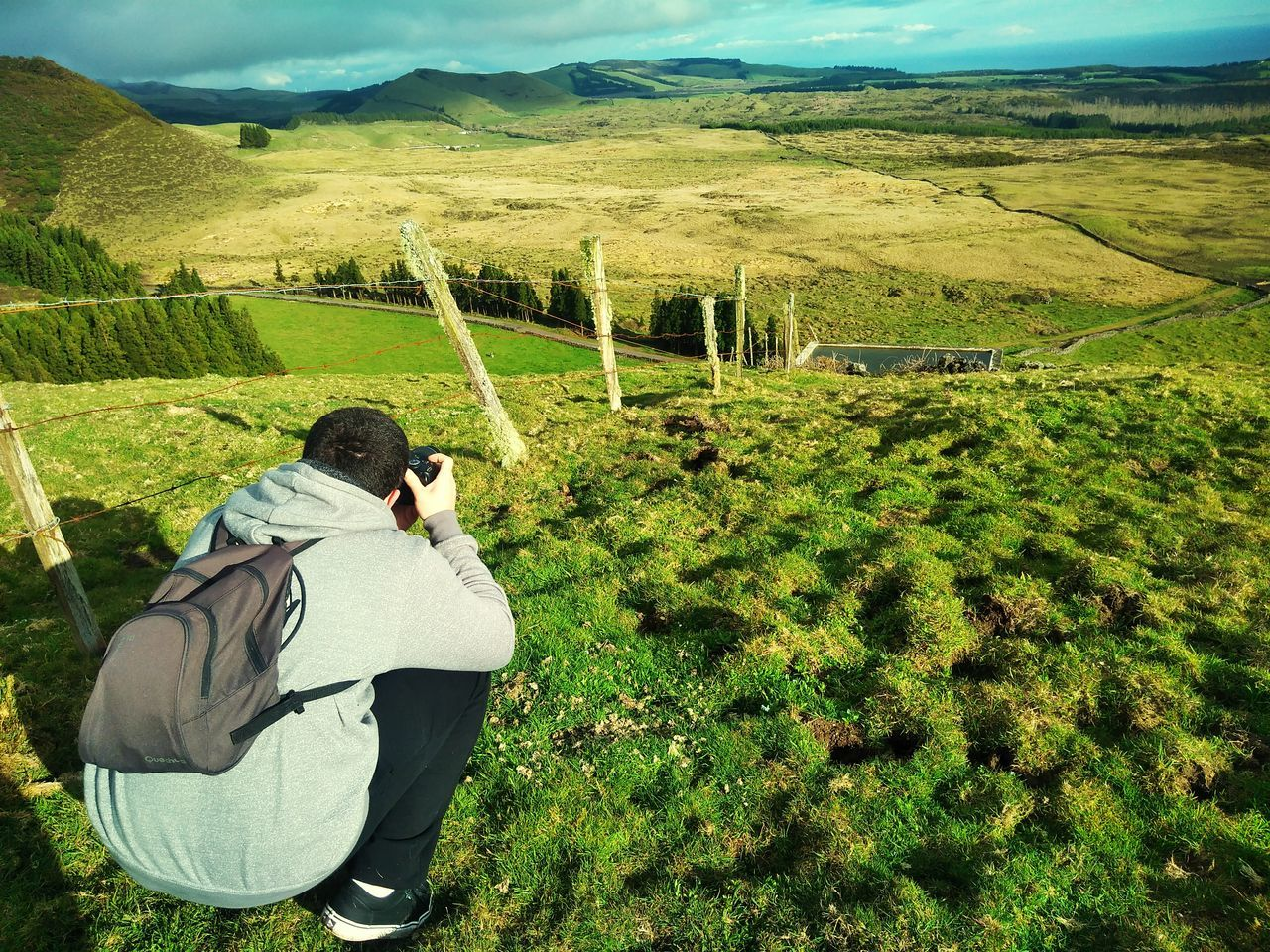 Photographer in action Only Men One Man Only One Person Sunlight Men Rural Scene Leisure Activity Green Color Landscape Day Adults Only Agriculture Outdoors Adult People Nature EyeEm Azores Eyeem Market EyeEmNewHere EyeEm Gallery Grass Beauty In Nature