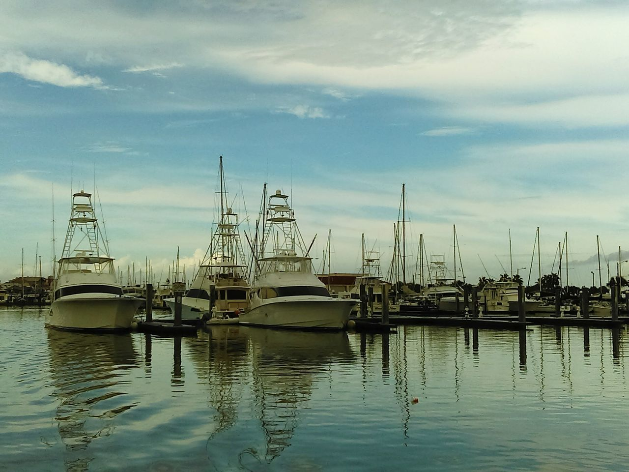 nautical vessel, moored, sky, transportation, mode of transport, cloud - sky, water, harbor, reflection, mast, boat, no people, nature, marina, outdoors, waterfront, day, tranquility, sailboat, commercial dock, scenics, yacht, beauty in nature