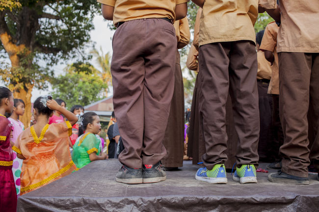 on stage Childhood Cultures Hair Decoration Indonesian Kids On Stage School Play School Uniforms Around The World Schoolkid Singing Sneekers Standing Traditional Clothing