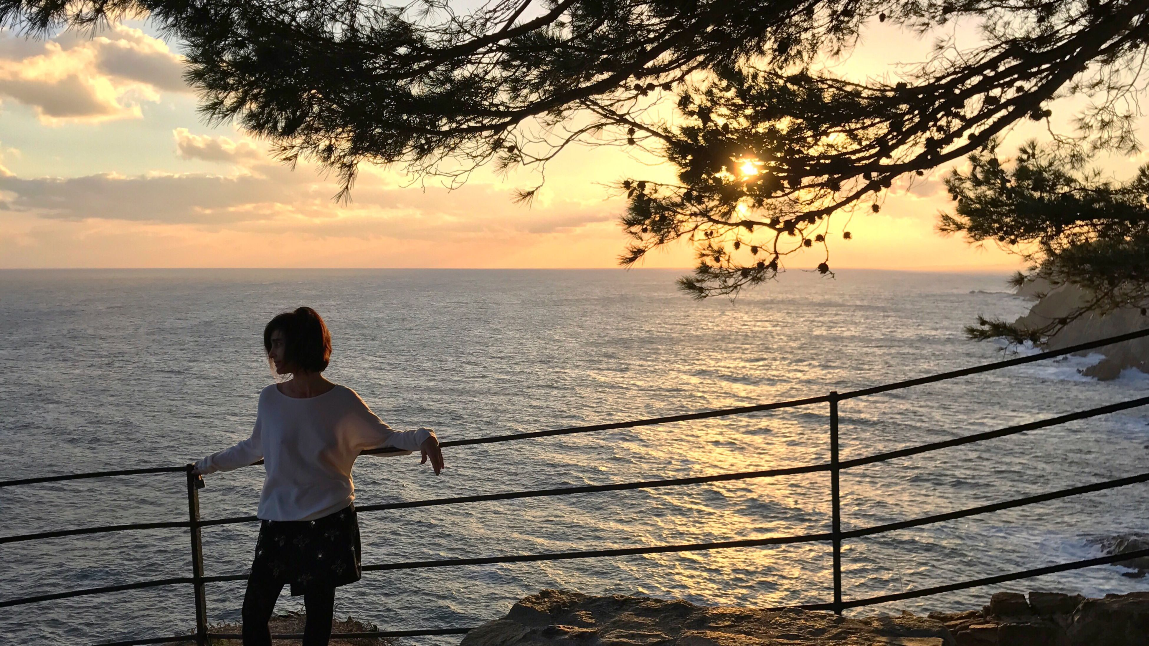 sunset, water, one person, rear view, child, sea, childhood, children only, nature, people, outdoors, vacations, tree, beauty in nature, sky, day, adult