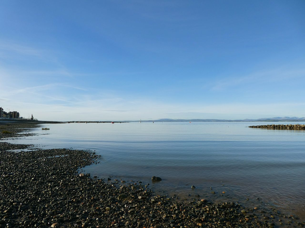 Another day at the seaside...flat calm peace and trsnquility. Sea Water Horizon Over Water Outdoors Nature Scenics Beauty In Nature Sky Tranquil Scene Beach Pebbles And Stones Blue Skies Calm No Wind Tranquility No People Day Keepitsimple Rippled Water Blue Picsartrefugees Bay Distant Mountains Simple Quiet Love