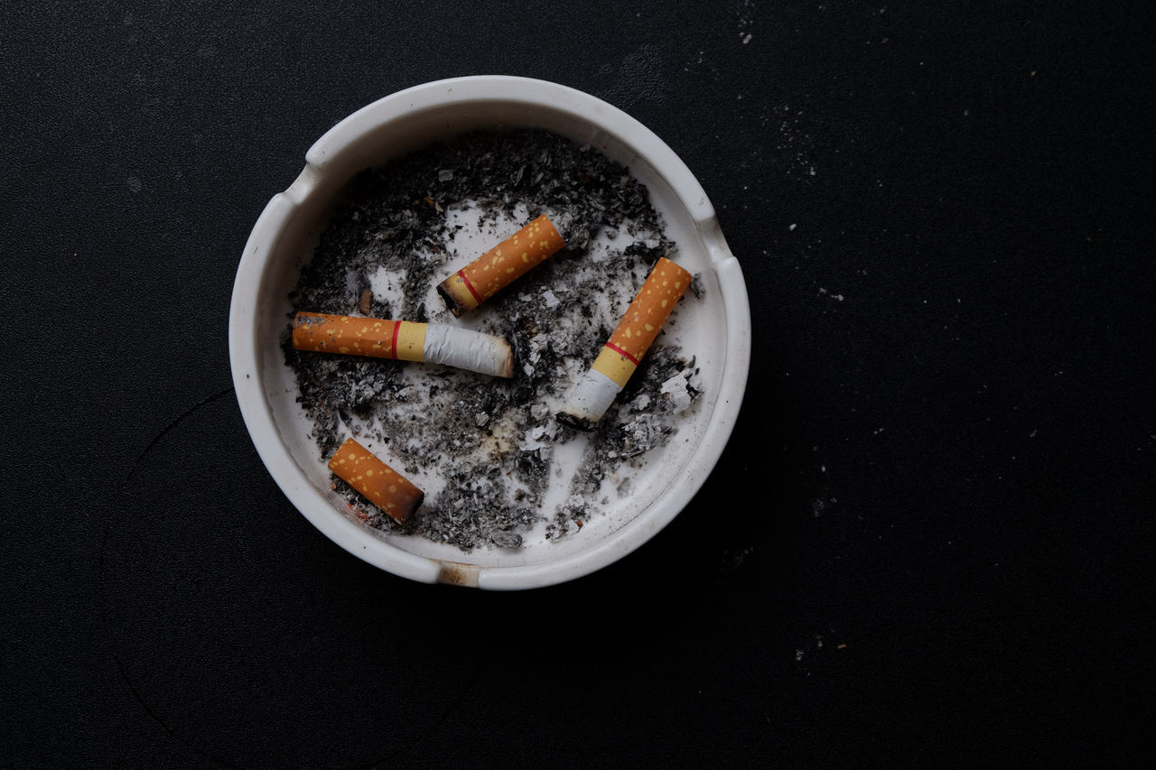 Addiction Ashtray  Bad Habit Black Background Burnt Cigarette  Cigarette Butt Cigarette Stub Close-up Danger No People RISK Smoking Issues Social Issues Table Tobacco Product