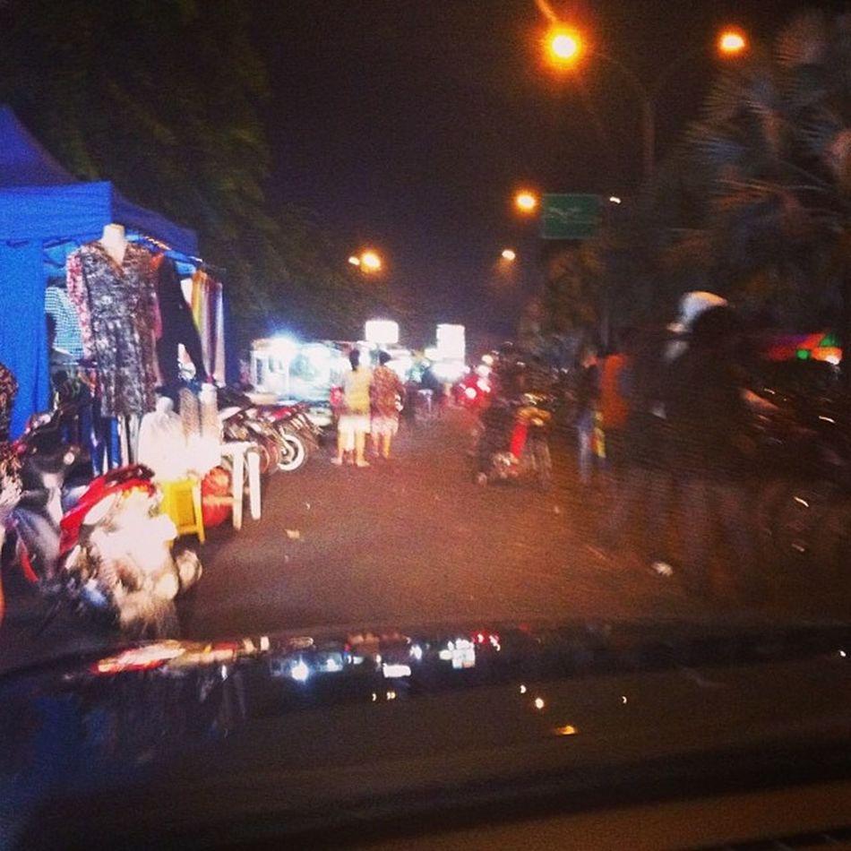 A long stretch of roadside stalls and bike Kemayoran Jakarta INDONESIA Followme followforfollow