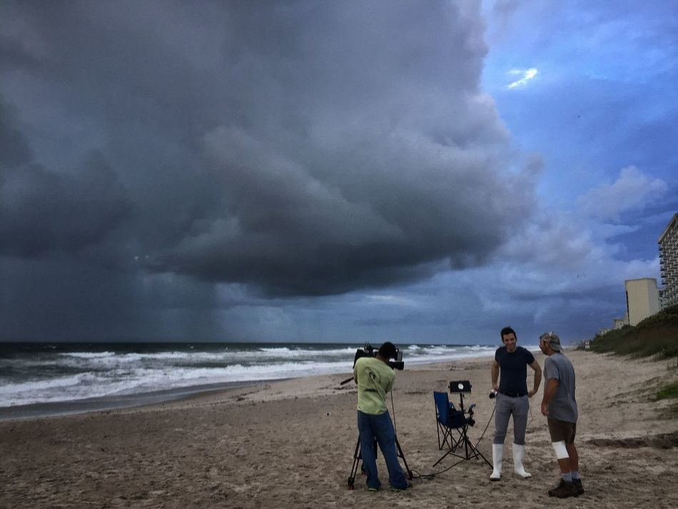 TV news crew on the beach Hurricane Matthew 2016 Melbourne Beach, FL Hurricane Matthew Hurricane News Coverage TV News Reporters Tv Camera Hurricane Weather Windy Day Oceanscape Cloudy Rain Clouds Storm Cloud Stormy Weather