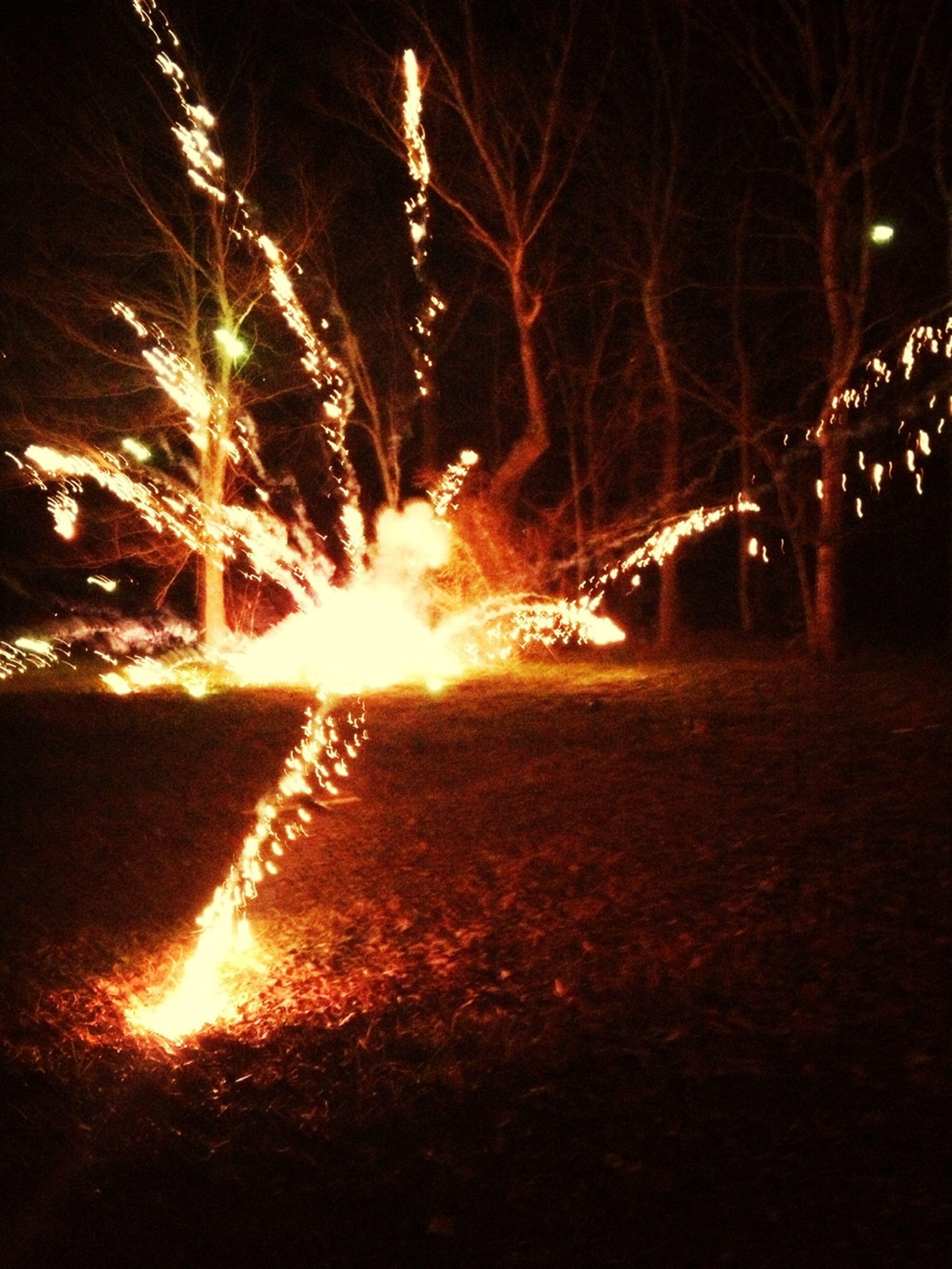 night, illuminated, glowing, long exposure, motion, fire - natural phenomenon, burning, light - natural phenomenon, dark, tree, firework display, outdoors, blurred motion, sparks, flame, exploding, celebration, no people, sky, orange color
