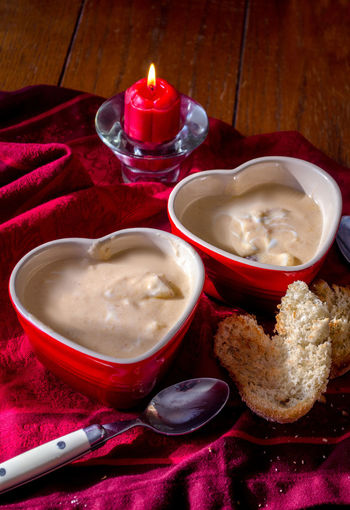 creamy lobster bisque soup served in red heart shaped bowls Food And Drink Freshness Hot Lobster Bisque Soup Love Red Romance Romantic Day Delicious Food Freshness Heart Bowls Hot Soup Indoors  No People Red Romantic Sky Savory Food Soup Valentines Day