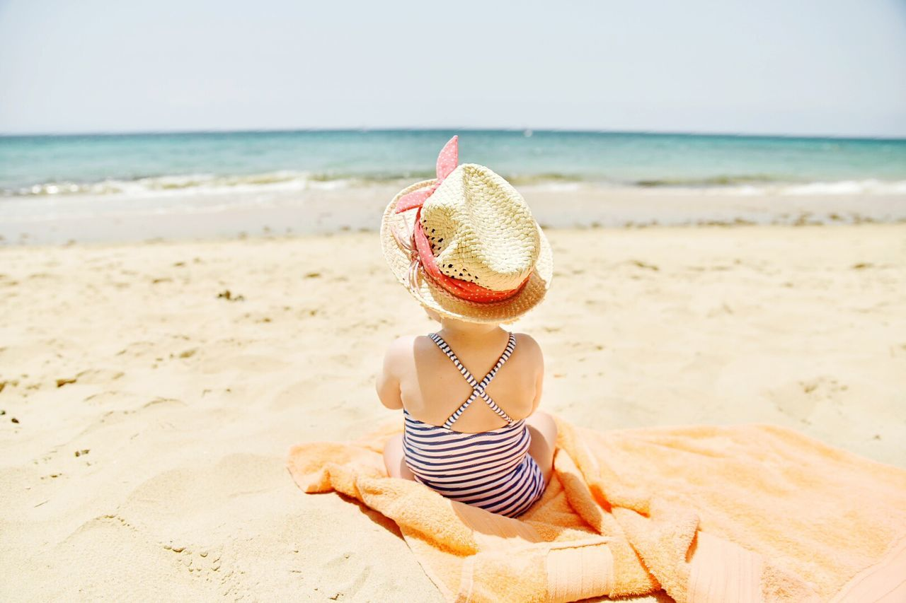 Summer Hat Beach Sand Sun Hat Straw Hat Sea Rear View Vacations Fashion Sunbathing Sun Beauty Lifestyles Relaxation Bikini Beautiful People Human Back Water Adult Live For The Story The Great Outdoors - 2017 EyeEm Awards