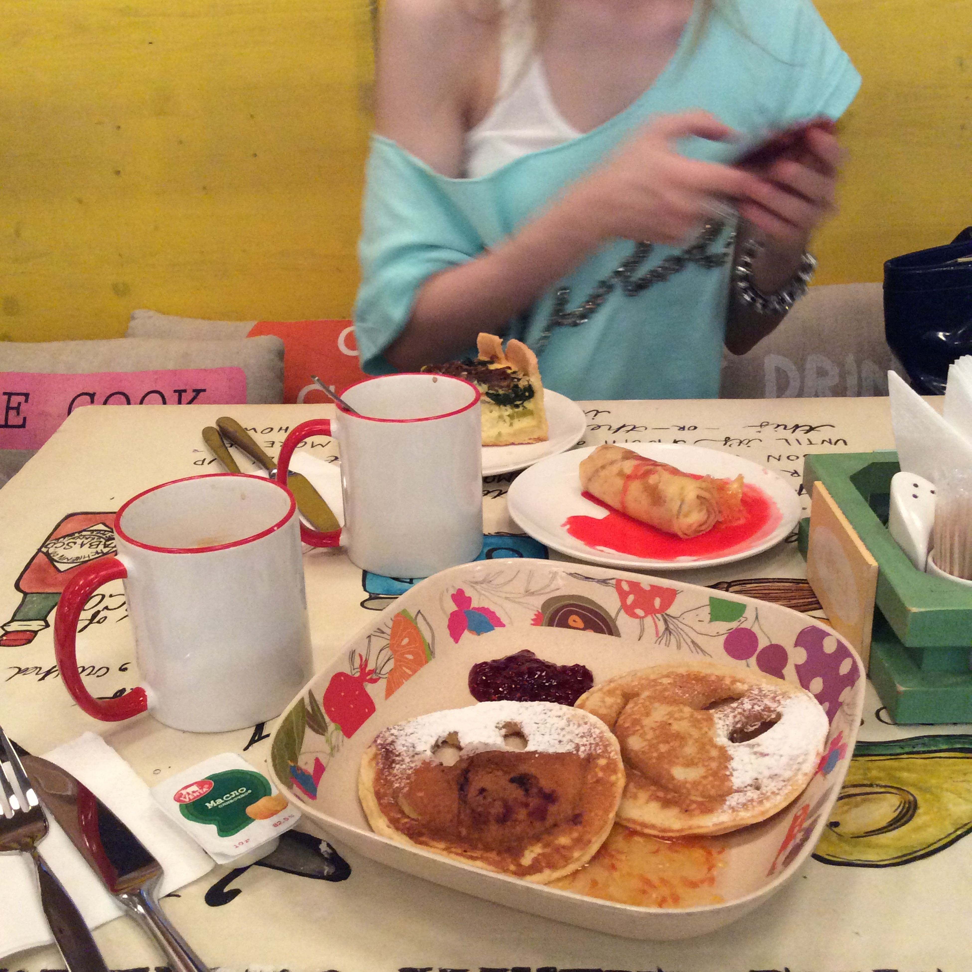 food and drink, indoors, food, freshness, person, holding, lifestyles, high angle view, table, men, sweet food, indulgence, unhealthy eating, ready-to-eat, leisure activity, unrecognizable person