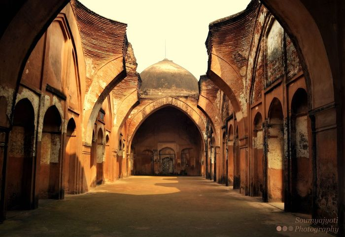 HISTORIC WHISPER, THE KATRA MASJID (MOSQUE)..!!! ---------------------------------------------------------------- This pic was clicked at the Katra Masjid, Murshidabad, West Bengal, India during my first ever visit to Murshidabad, January'16. Since childhood, I always heard about this historic place but unfortunately never been able to visit. However, post marriage, I got the opportunity as this the native place of my in-laws. Though Murshidabad is very popular for Hazarduari i.e. the house with thousand doors (the most conspicuous & imposing building) but when I visit this Katra Mosque I was like stunned by its beautiful architecture and felt shameful that I visited so many other historic places in india (Delhi, Agra and etc.) but not even once here despite of being a Bengali. Though the mosque has been destroyed in the 1897 earthquake but still does not looses its beauty (paradise for any photographer), just by looking at its architecture one can understand how serene it was and how strong the construction technique at that time in India.. ----------------------------------------------------------- P. S - The History of Murshidabad and Katra Masjid is quite eventful and lengthy enough but in brief, Katra Mosque is built by Murshid Kuli Khan (The place Murshidabad is named after him) in 1723-24 A.D as centre of islamic learning (Madrasa). The word 'Katra' means a market and the name was given to the mosque owing to the fact that the place had a large market around the mosque during that time. Murshid Kuli Khan was buried there after his death 1725 A.D under the stairs of entrance of the mosque and more interestingly this has been done as per Nawab Murshid Kuli Khan's own wish who was repentant for the misdeeds committed by him (He wanted to be buried in such a place where he could be trodden and could get the foot prints and the touch of the feet of the noble men who climb those stairs and enter the mosque) !!! Now it is taken over and maintained by Archaeological 