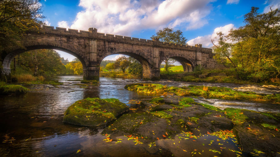 ~The crossing~... Bridge - Man Made Structure Arch River Reflection Water Autumn Cloud - Sky Landscape Outdoors Scenics Taking Photos Malephotographerofthemonth LumixG80 Landscape_Collection Colour Landscape_photography Streamzoofamily EyeEm Best Shots Colours Foliage Wide Angle Colourful October Tree Beauty In Nature