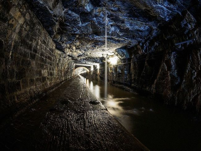 The Falkirk tunnel, which is carved through 631 meters of solid rock and part of the Union Canal in central Scotland. Falkirk Tunnel Falkirk Tunnel Union Canal Canal Rock Darkness And Light Dark Scotland Nobody Darkness