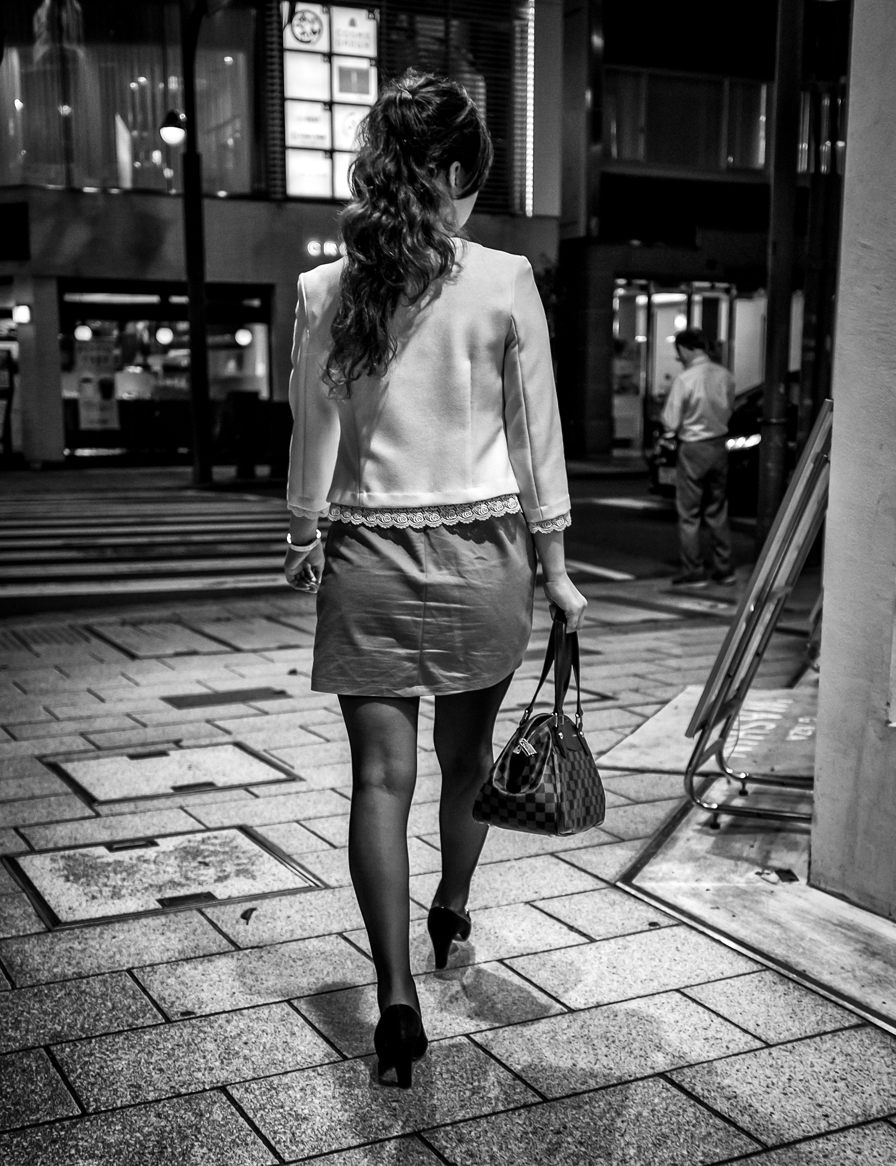 lifestyles, full length, rear view, casual clothing, person, walking, leisure activity, street, sidewalk, standing, city life, building exterior, city, incidental people, men, footpath, outdoors, front view