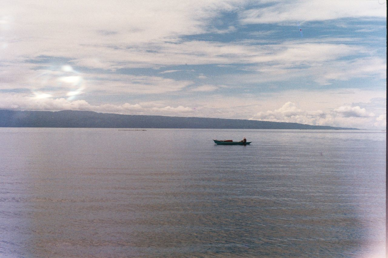 Fisherman's nest Bais Negros Oriental Philippines Outdoors Nature Nautical Vessel Cloud - Sky Sky Sea Beauty In Nature Boat Fisherman Film Photography 35mm Film Photography Olympus OM1 Olympus Om1 Unedited Unfiltered Sea And Sky Calm Sea Manjuyod