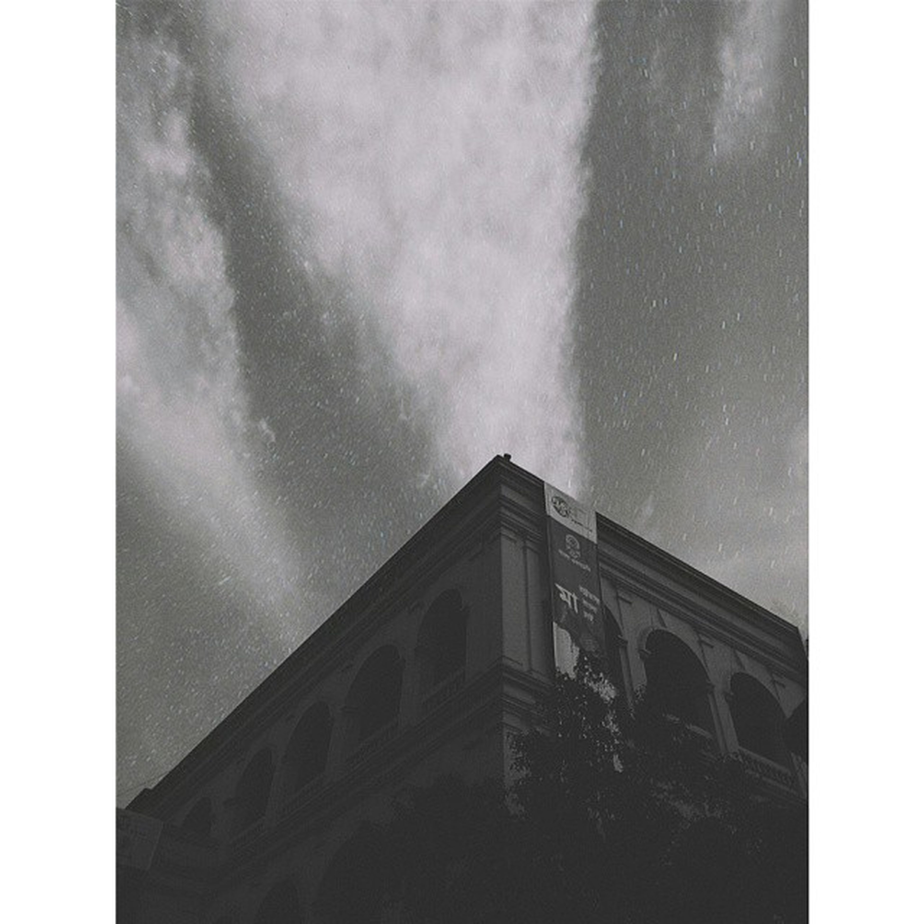 transfer print, architecture, built structure, building exterior, low angle view, sky, auto post production filter, cloud - sky, cloudy, building, overcast, weather, high section, no people, outdoors, window, cloud, day, nature, copy space