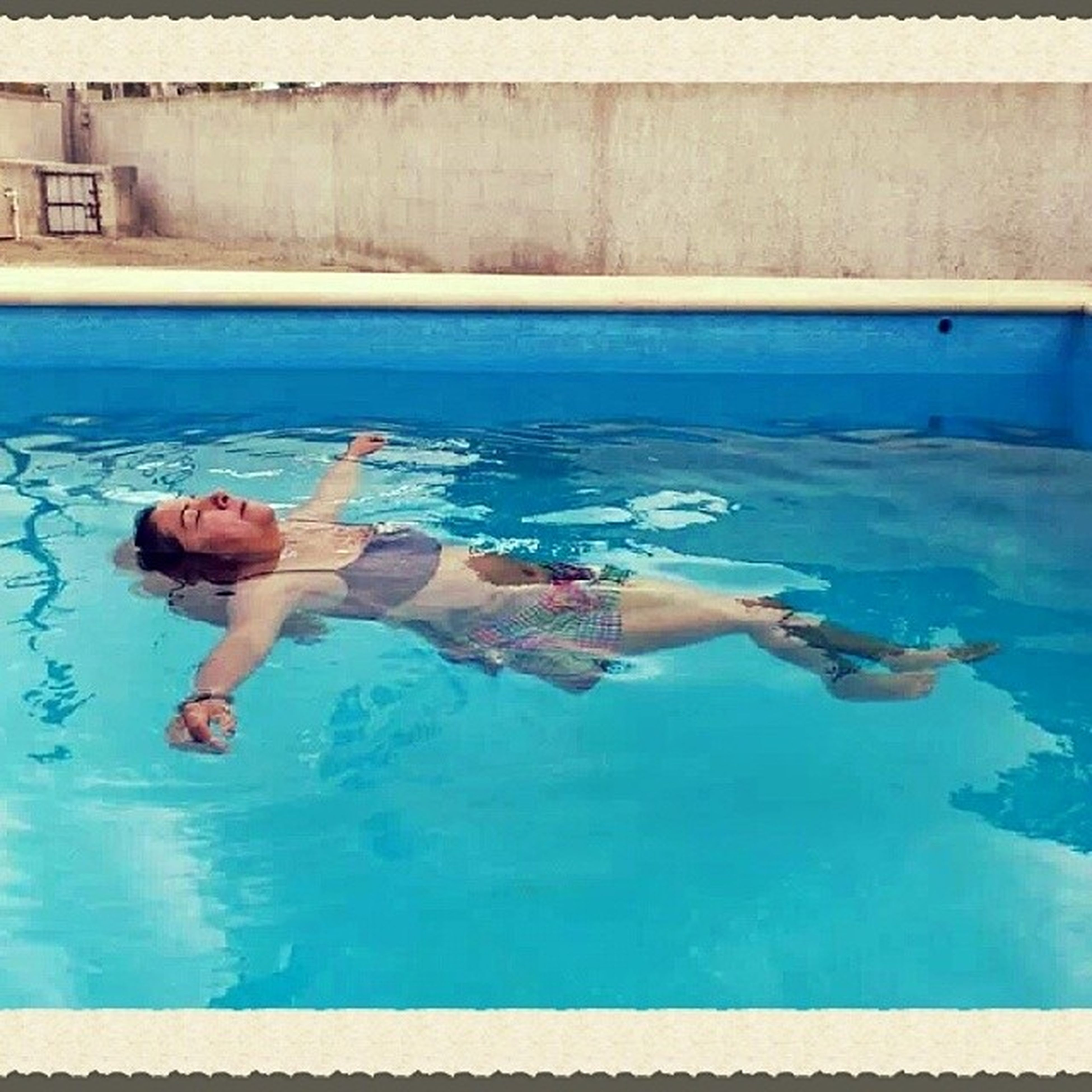 lifestyles, leisure activity, water, swimming pool, blue, full length, sea, standing, person, built structure, vacations, enjoyment, childhood, boys, architecture, turquoise colored