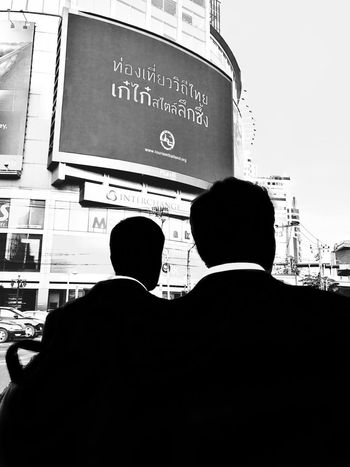 Decha EyeEm Best Shots - Black + White EyeEm Best Shots The Street Photographer - 2017 EyeEm Awards Mobilephotography Streetphotography Street Photography Bangkok Text Communication Built Structure Architecture Real People Day Men Rear View Transportation Travel Destinations Outdoors Building Exterior City One Person Sky Adult People