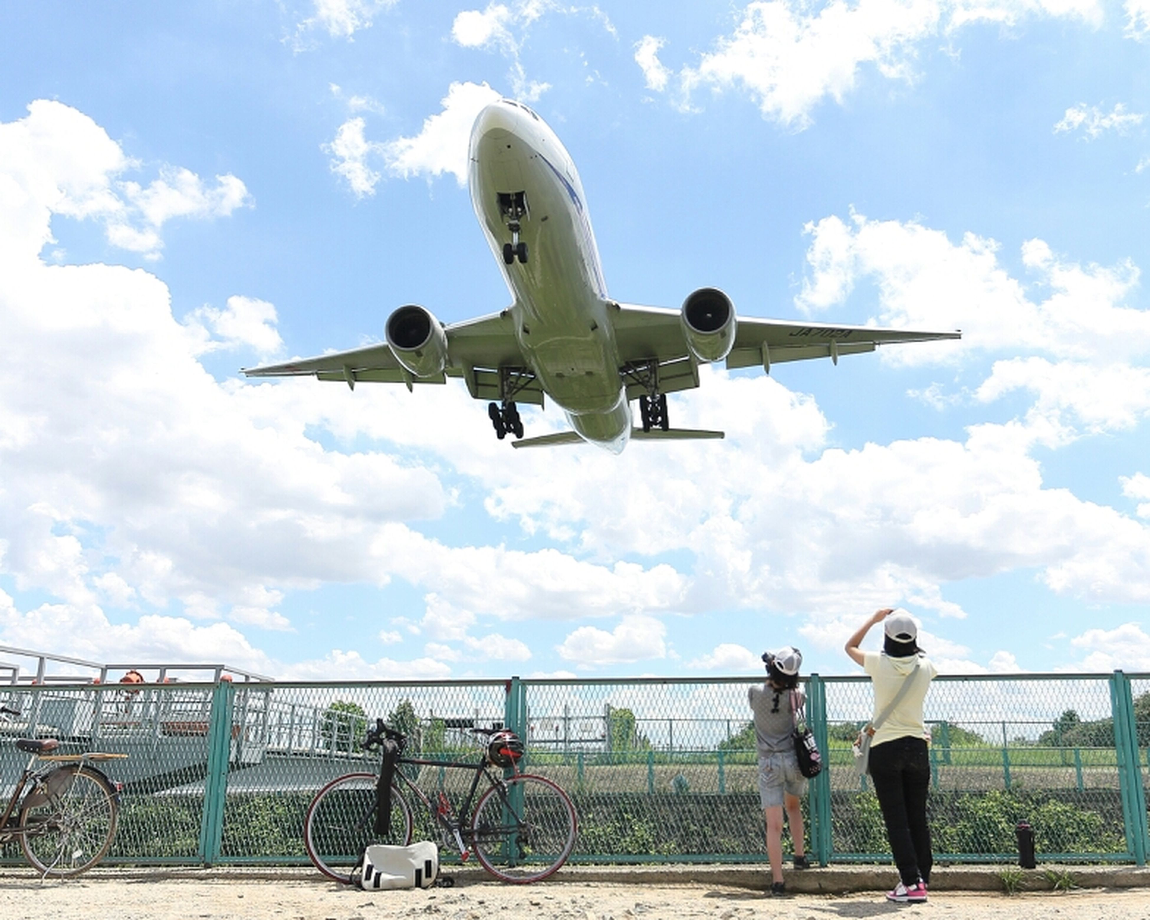lifestyles, transportation, sky, airplane, travel, air vehicle, leisure activity, mode of transport, men, cloud - sky, mid-air, tourism, tourist, architecture, built structure, journey, full length, person