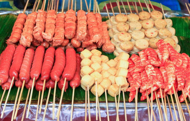 Hotdog grill skewer with bamboo. Street Food in Thailand. Abundance Bell Pepper Business Close-up Food For Sale Freshness HotDog Large Group Of Objects Market