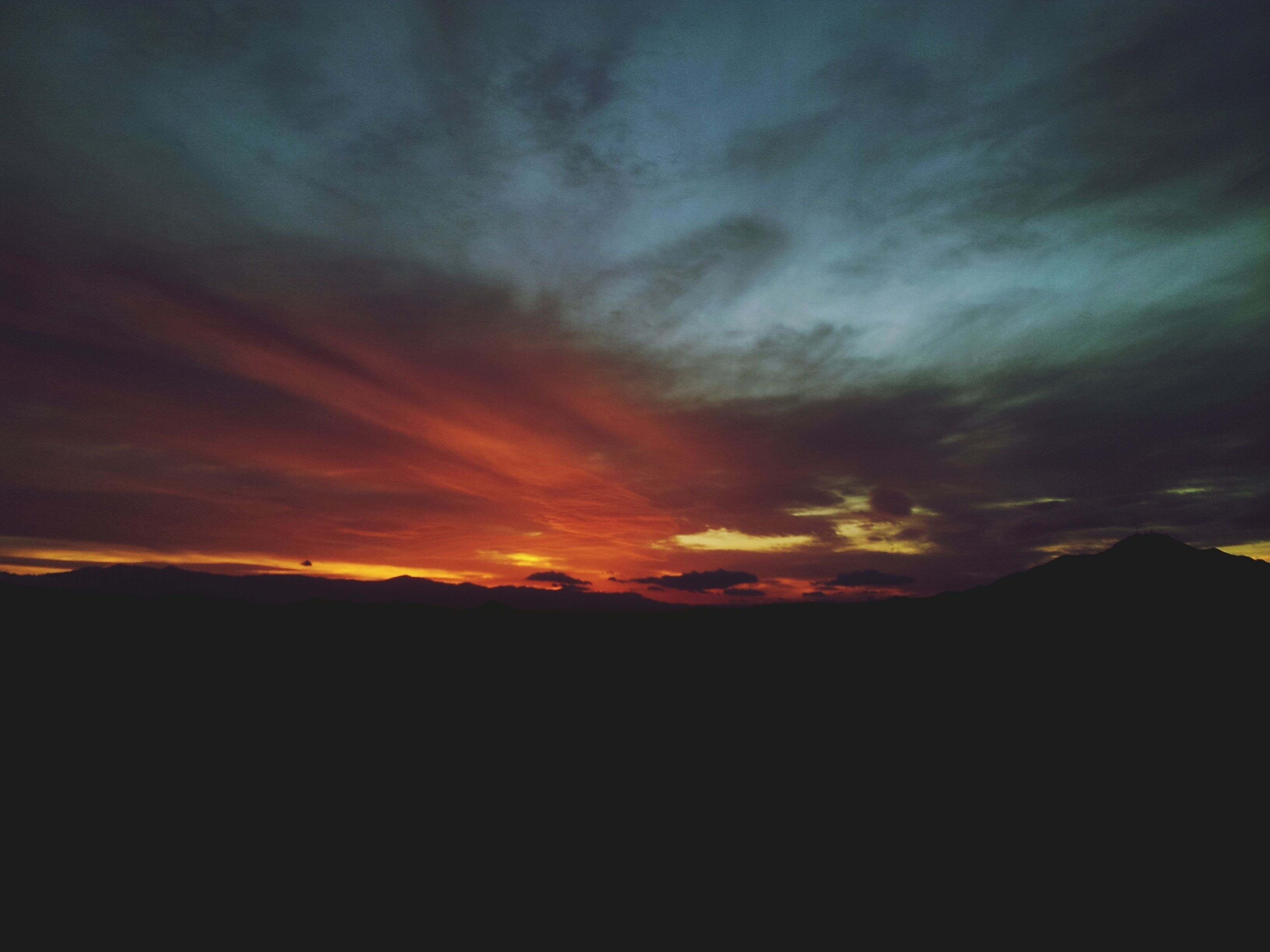 sunset, scenics, sky, silhouette, tranquil scene, beauty in nature, tranquility, cloud - sky, orange color, dramatic sky, idyllic, nature, landscape, cloudy, cloud, dark, majestic, mountain, atmospheric mood, dusk