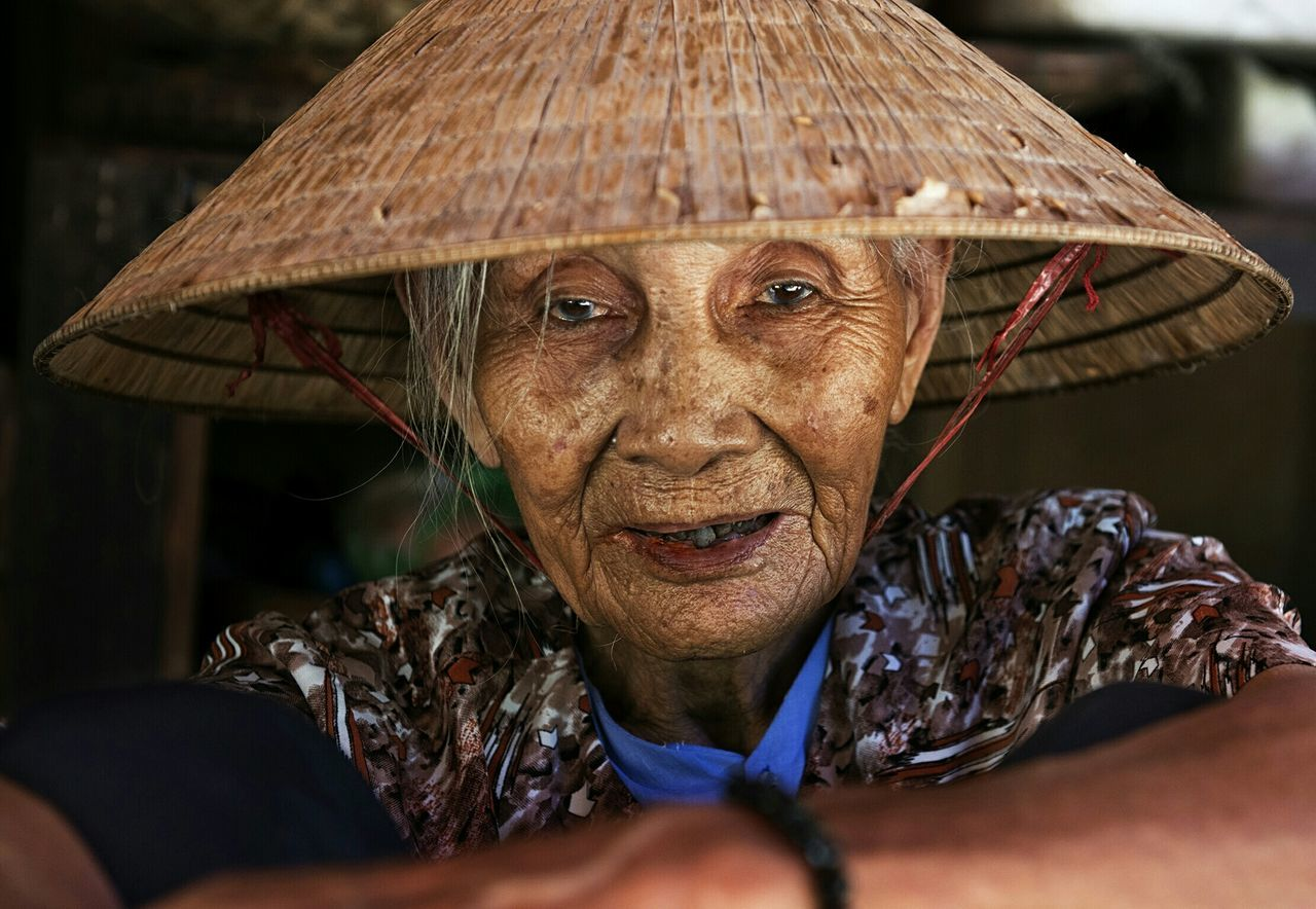 Beautiful stock photos of vietnam, close-up, focus on foreground, looking at camera, person