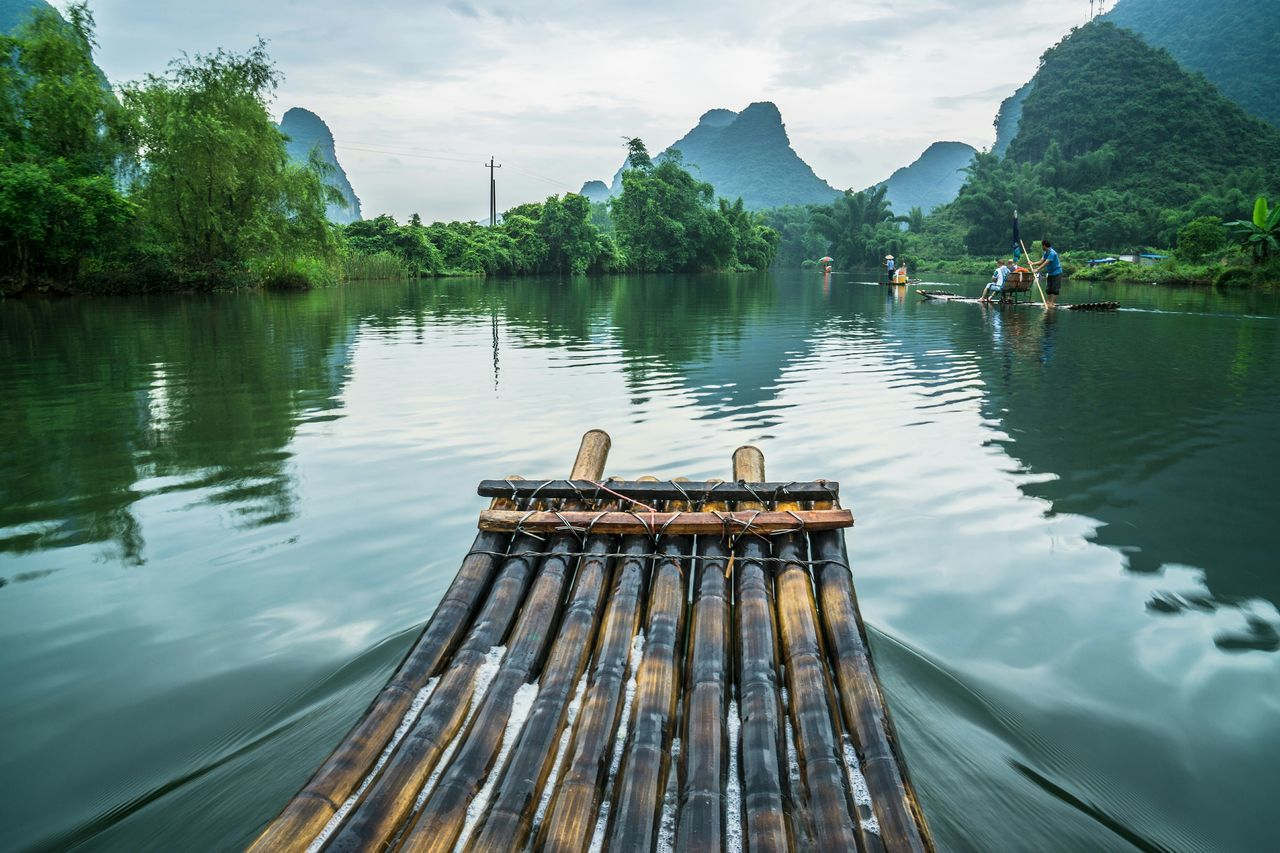 Lets move. A journey with Bamboo raft on Li River, Guilin, Yangshou, China Bamboo River Yangshuo Mountains Rafting Beauty In Nature Reflection The Traveler - 2015 EyeEm Awards Travel Destinations Li River The Week On EyeEm Feel The Journey Fine Art Photography Hidden Gems  Color Of Life