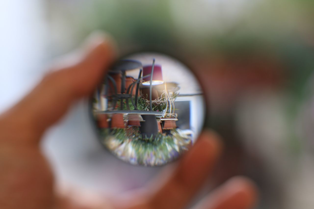 human body part, real people, one person, human hand, unrecognizable person, selective focus, close-up, holding, eyesight, men, camera - photographic equipment, day, human eye, technology, indoors, eyeball, people