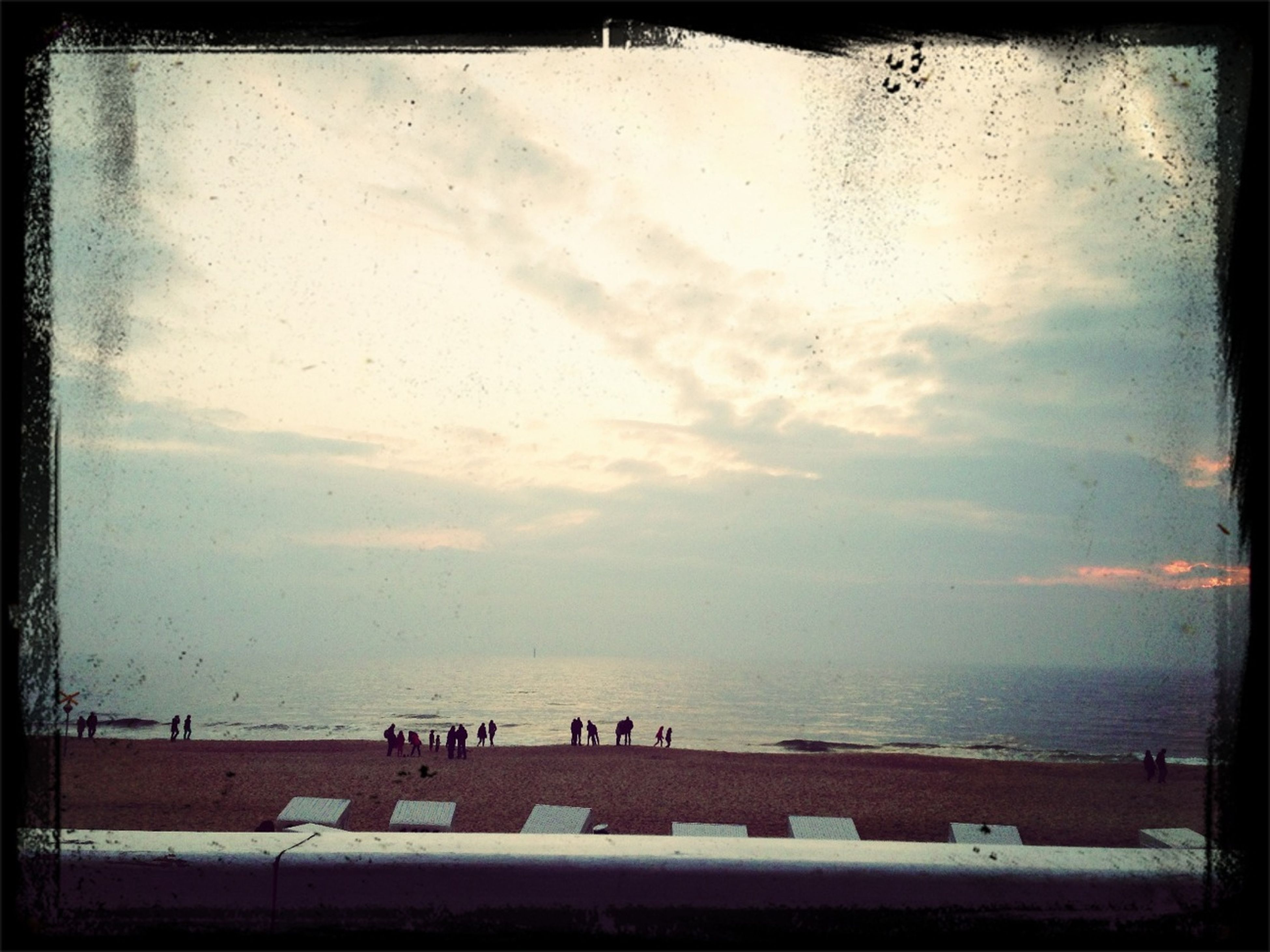 sea, transfer print, water, horizon over water, beach, sky, auto post production filter, scenics, shore, tranquil scene, cloud - sky, beauty in nature, tranquility, nature, large group of people, incidental people, sand, sunset, idyllic