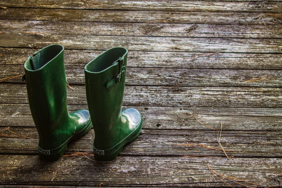 Shoe Pair Wood - Material Still Life High Angle View Indoors  Things That Go Together Table No People Hardwood Floor Day Close-up Rain Boots Boots Dock Boat Dock Rainboots