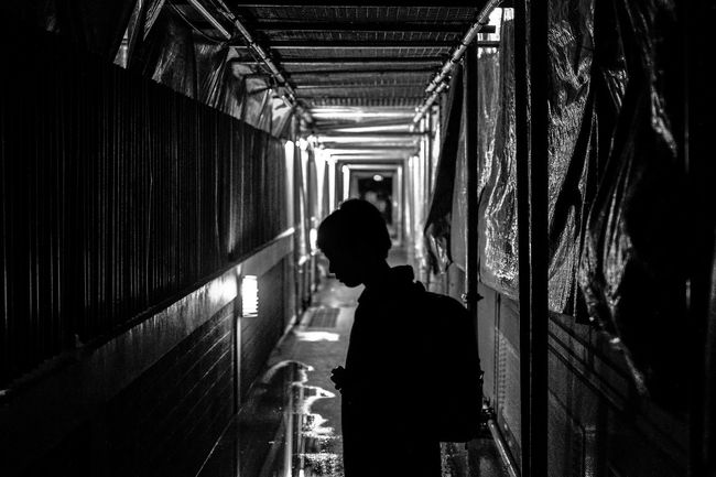 I hide behind shadows Monochrome Photography One Person Indoors  Silhouette People Real People Adult Horizontal Person Night Philippines Manila Moments Architecture Lifestyles Silhouette Street Timeless Fujifilm Pedestrian Walkway Road Alley Vanishing Point Life Priceless