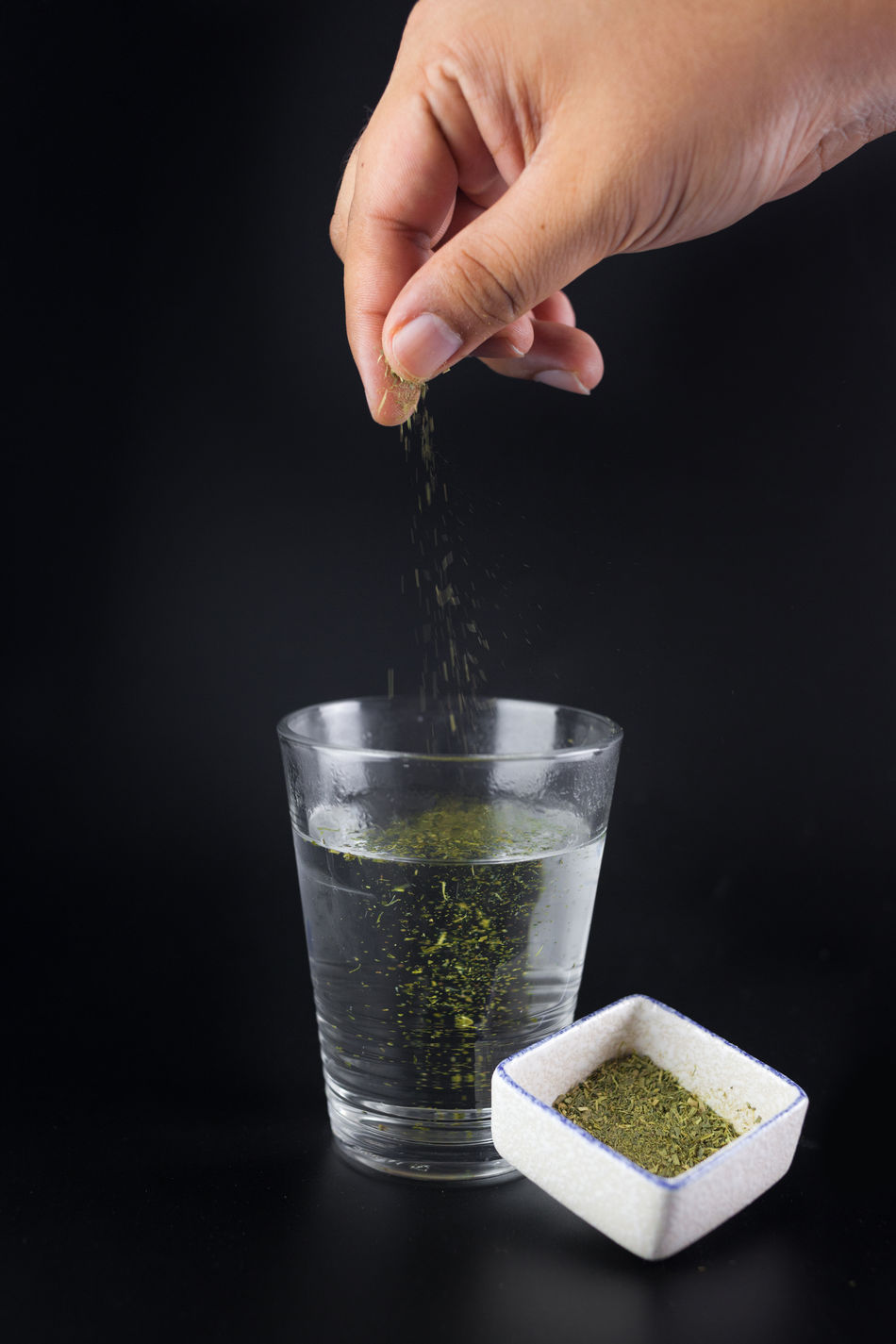 Black Background Dark Background Drinking Glass Green Green Tea Human Hand Motion Product Product Photography Product Shooting Sprinkle Studio Studio Shot