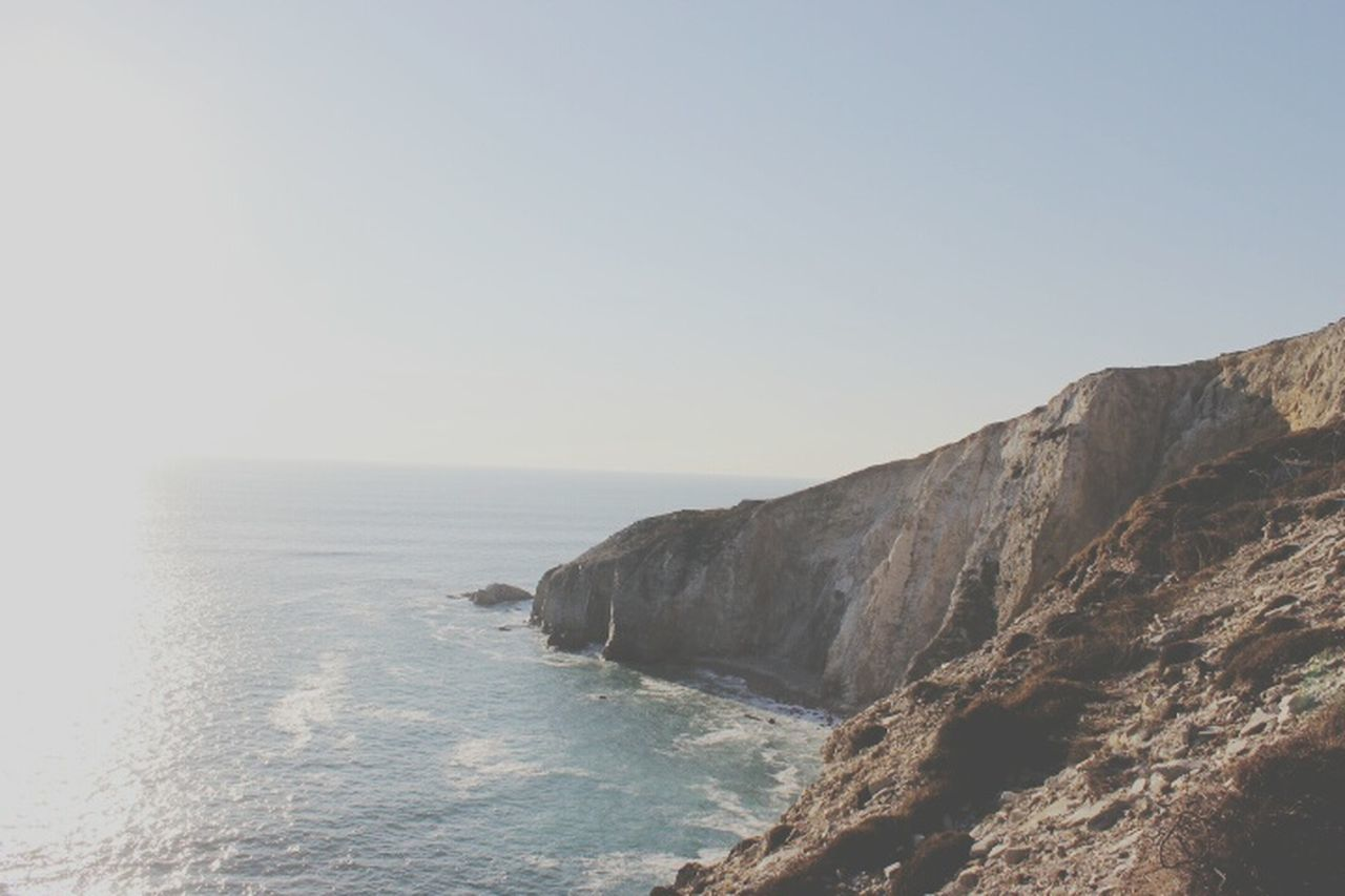 sea, clear sky, nature, scenics, tranquil scene, water, beauty in nature, tranquility, copy space, no people, outdoors, horizon over water, sky, cliff, day, scenery
