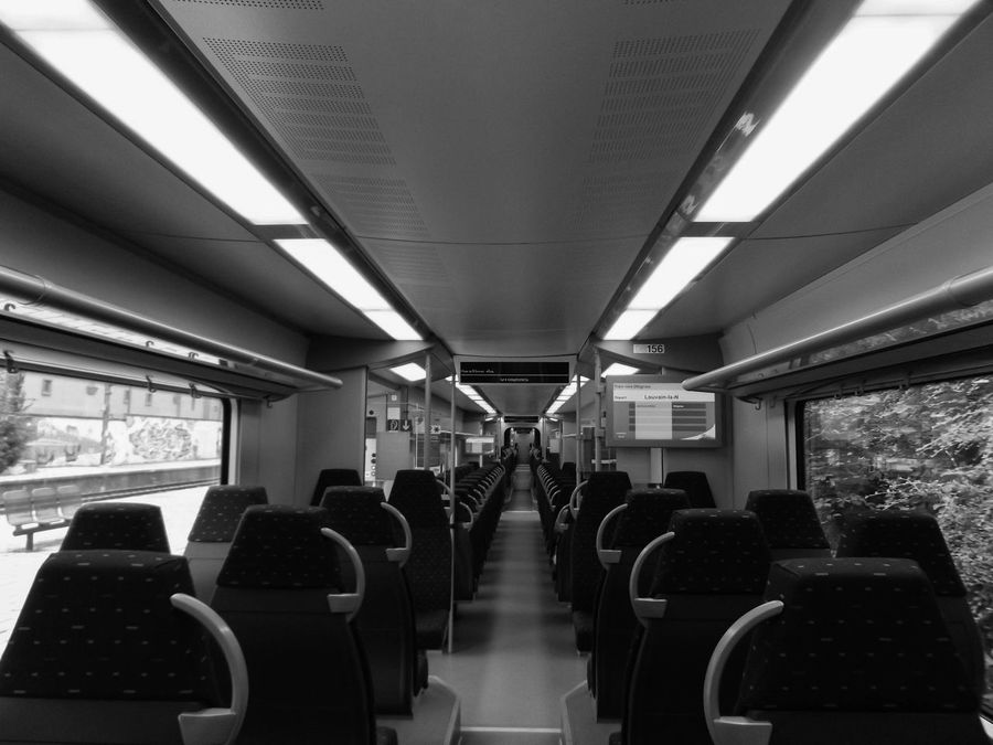 All Aboard. Corridor Day Illuminated In A Row Interior Lifestyles Lobby Modern Repetition Seat Vehicle Seat Train Train Station Public Transportation Design Black And White Bnwphotography The Way Forward Lighting Equipment Lit Light Windows Railway