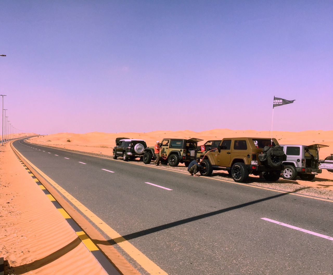 Off roading Transportation Car Land Vehicle Mode Of Transport Outdoors Desert Clear Sky Sky Day Nature Refueling No People