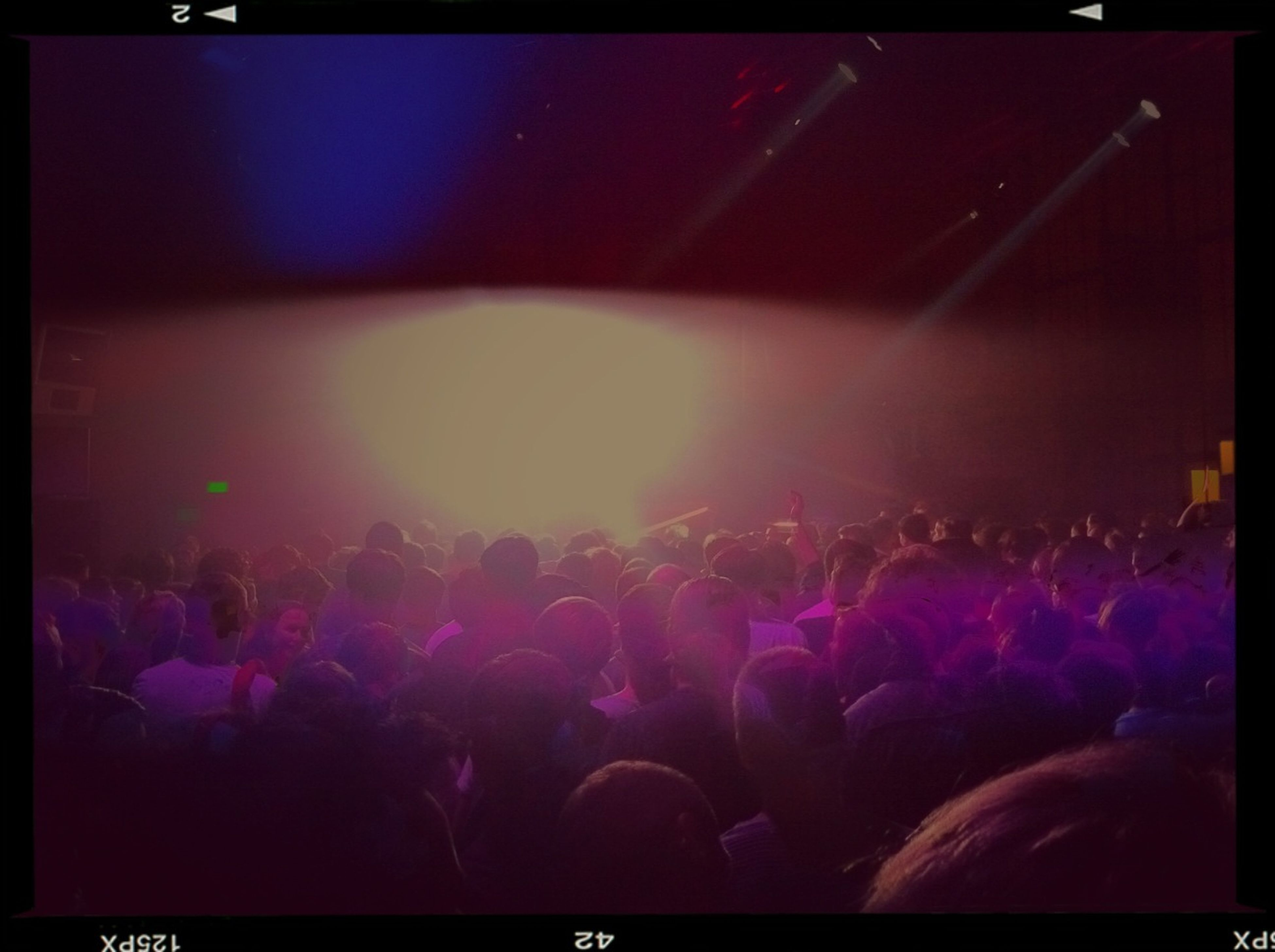 transfer print, illuminated, indoors, night, large group of people, music, arts culture and entertainment, auto post production filter, crowd, nightlife, lifestyles, men, event, concert, performance, enjoyment, person, leisure activity, light - natural phenomenon