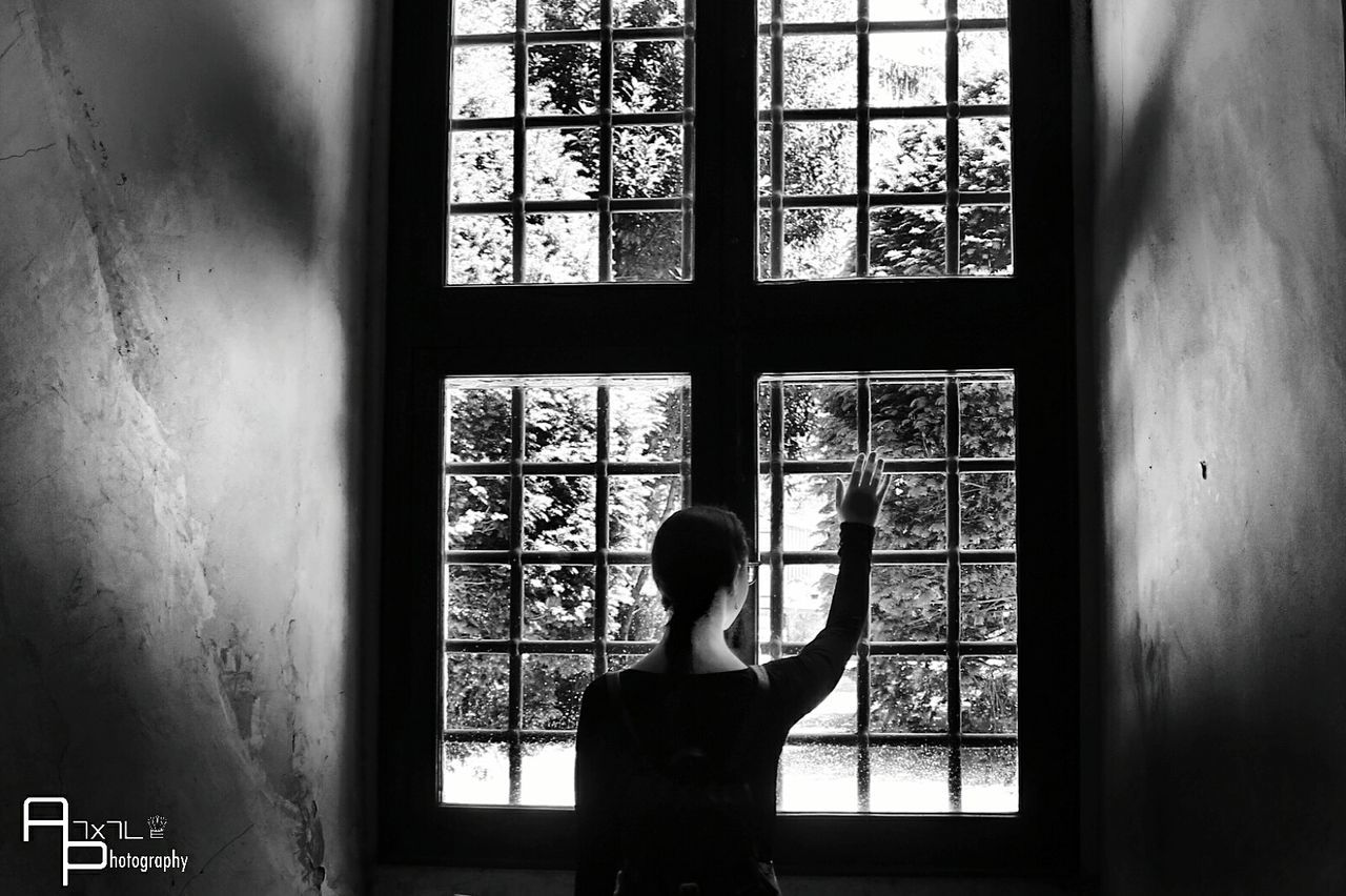 window, indoors, real people, one person, day, standing, looking through window, women, lifestyles, architecture, people