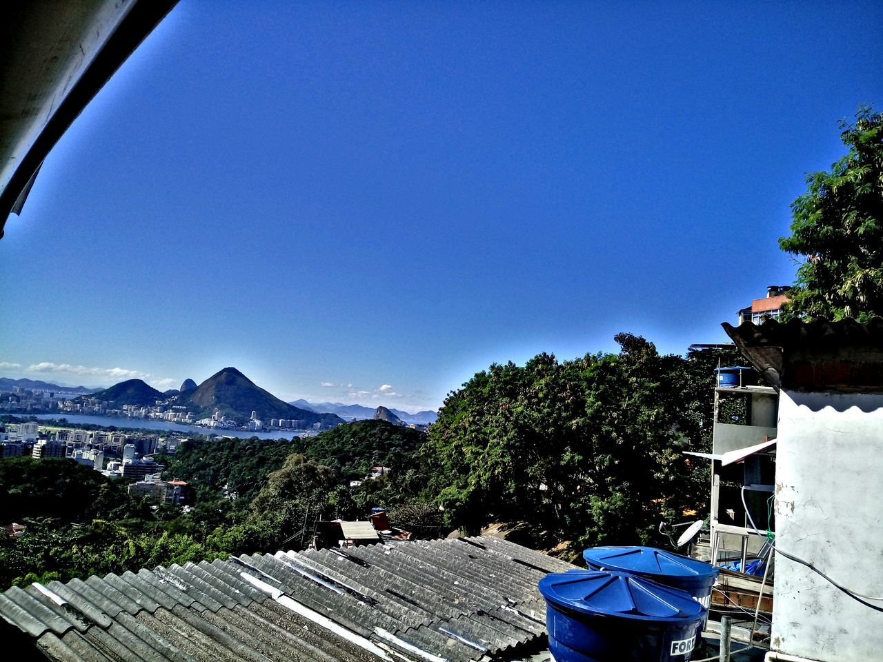 blue, architecture, building exterior, built structure, tree, no people, day, clear sky, outdoors, nature, mountain, sky